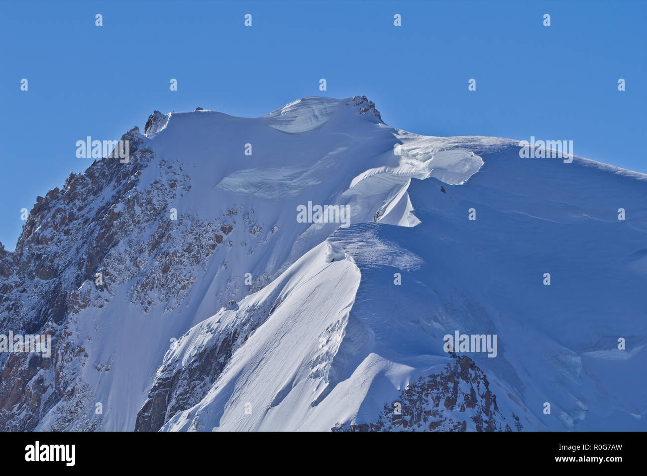 The Aiguille du Midi, The Alps are the highest and most extensive mountain range system that lies entirely in Europe, stretching approximately 1200 km - Stock Image
