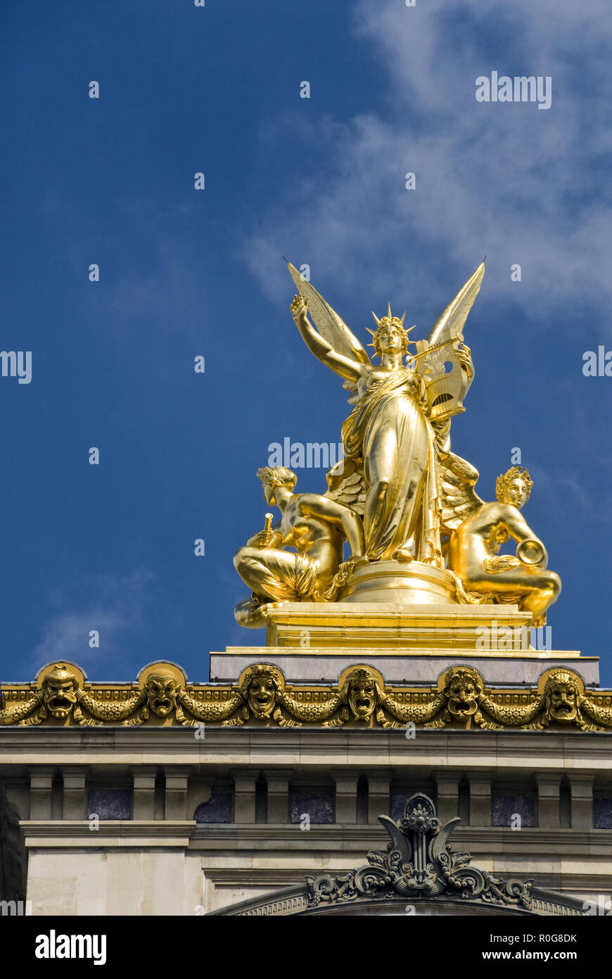 "A gold sculptural group atop the Palais Garnier opera house, famous as the setting for Leroux's 1910 novel 'The Phantom of the Opera,"" Paris, France. - Stock Image"