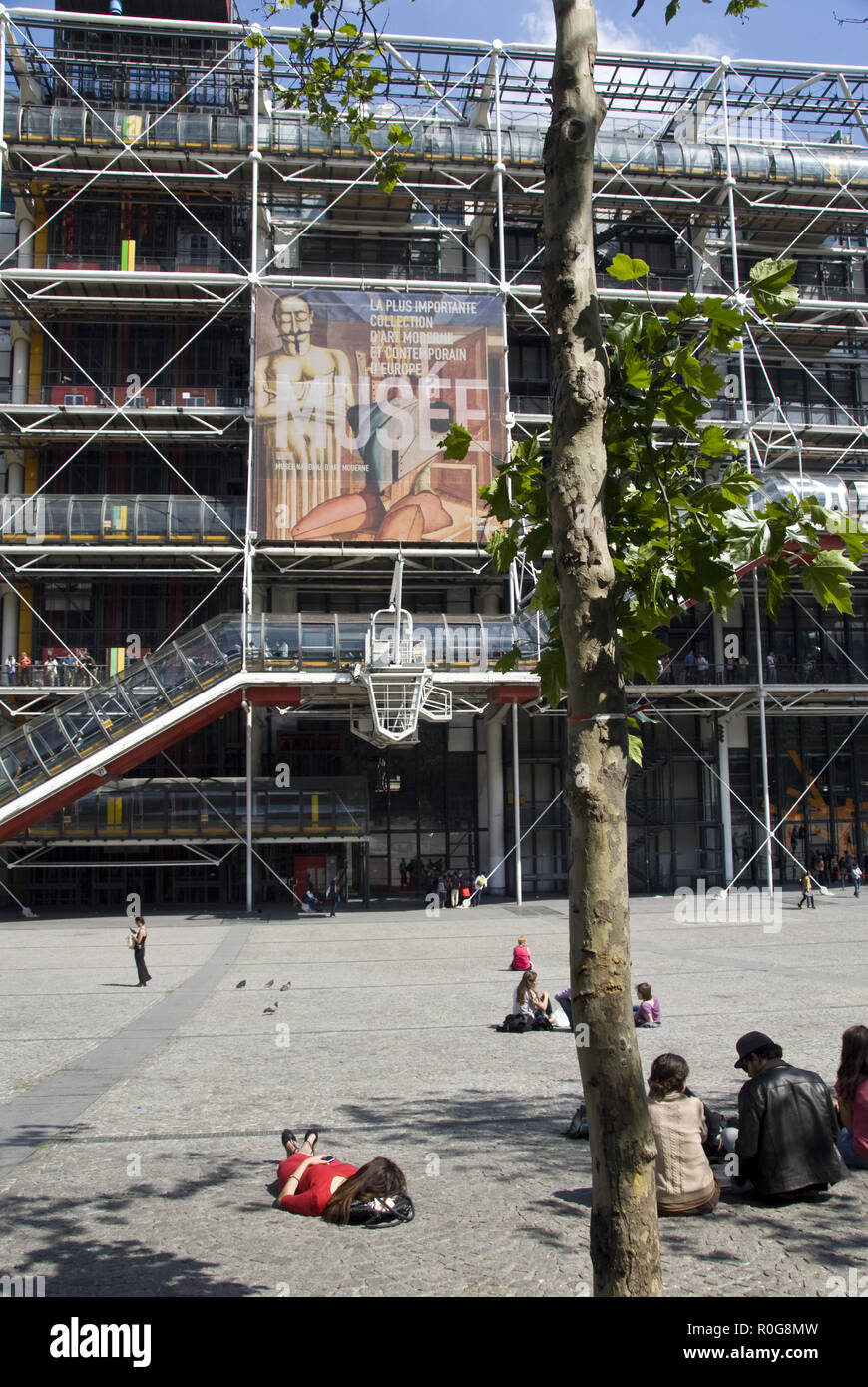 People relax on the plaza outside the Centre Georges Pompidou (Pompidou Center), a Postmodern multicultural arts complex, Paris, France. Stock Photo