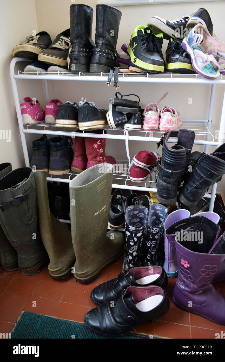 Prepared for all weathers, slippers,shoes,boots,trainers,wellington,wellingtons, shoe - Stock Image