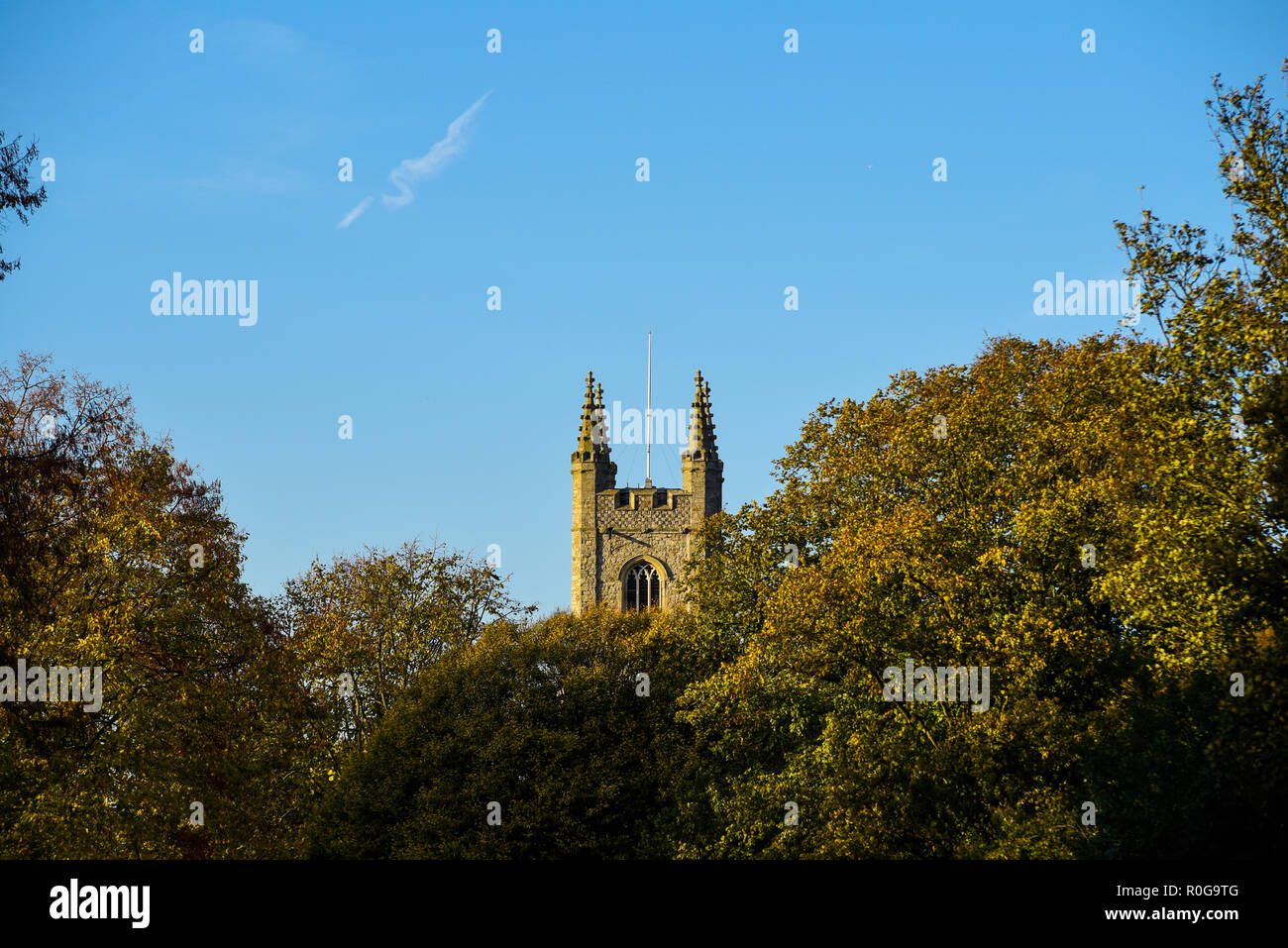 Church of Saint Mary the Virgin in Prittlewell the mother church of the growing borough of Southend. Early Autumn trees, fall colours. Space for copy Stock Photo