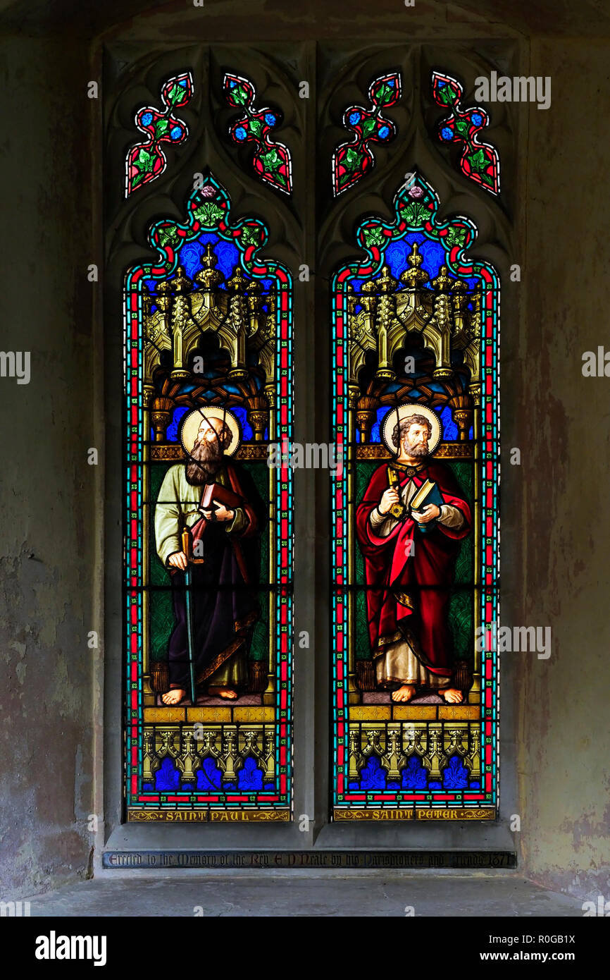 The Victorian stained glass memorial window to Revd Neale erected in 1871 and showing Saints Peter and Paul. Stock Photo