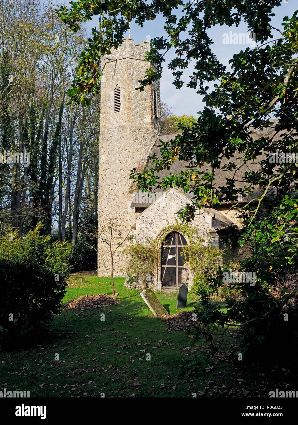 The village church in Horsey, Norfolk is one of many in the county with a round tower rarely found outside East Anglia. Stock Photo