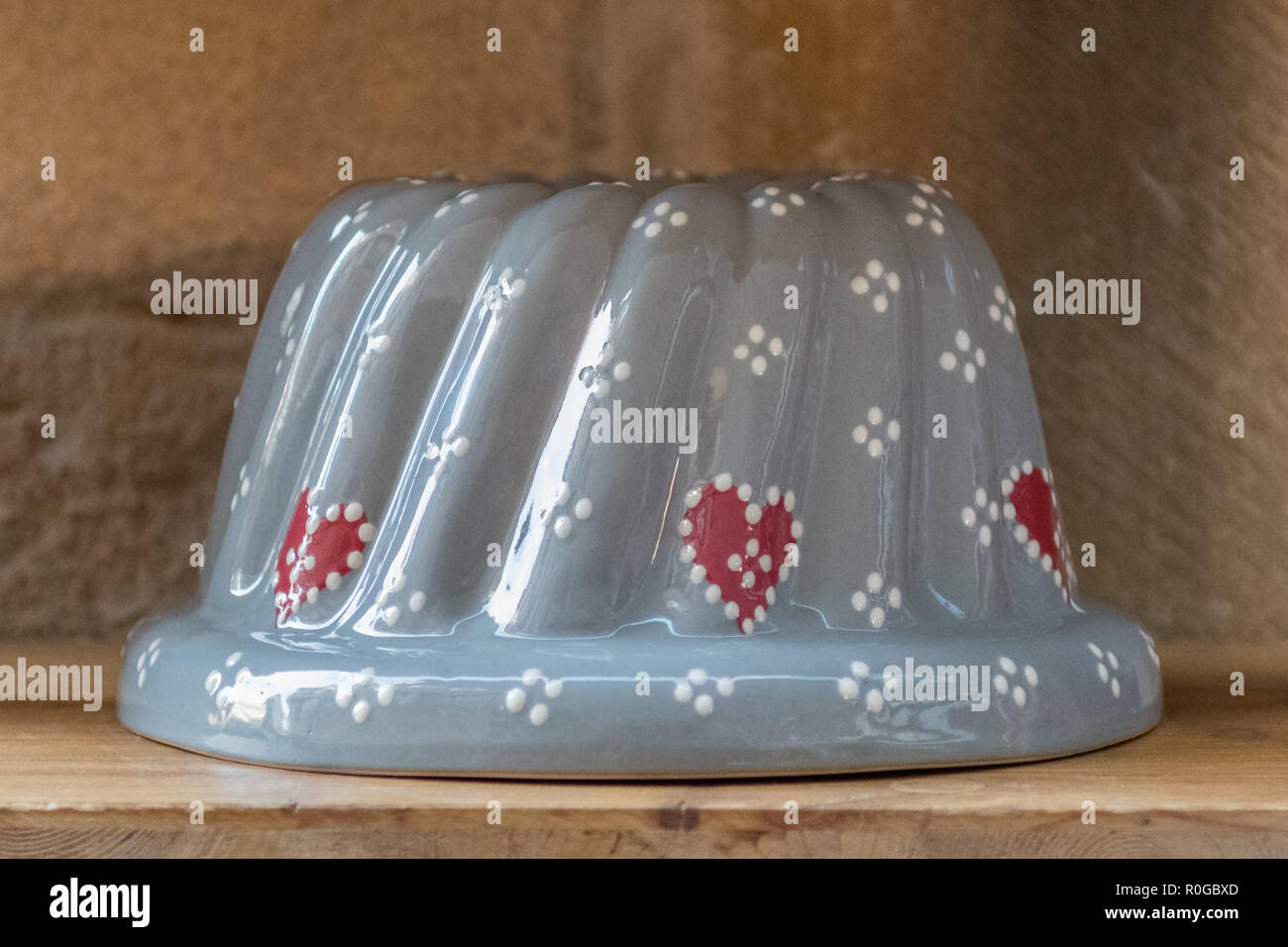 Traditional ceramic Kugelhopf bundt pan mold, Alsace, France - Stock Image