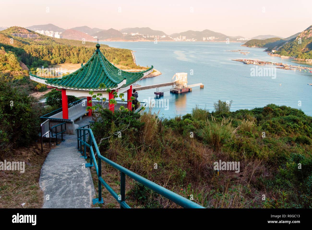 Sok Kwu Wan bay scenery from Family Walk trail on Lamma Island, Hong Kong. Chinese pagoda on observation platform - Stock Image