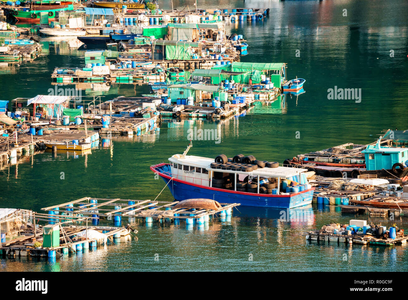 Hong Kong, China - January 25, 2016: Fish farming rafts in the bay of Sok Kwu Wan fisherfolks village viewed from the observation deck of the Family W - Stock Image