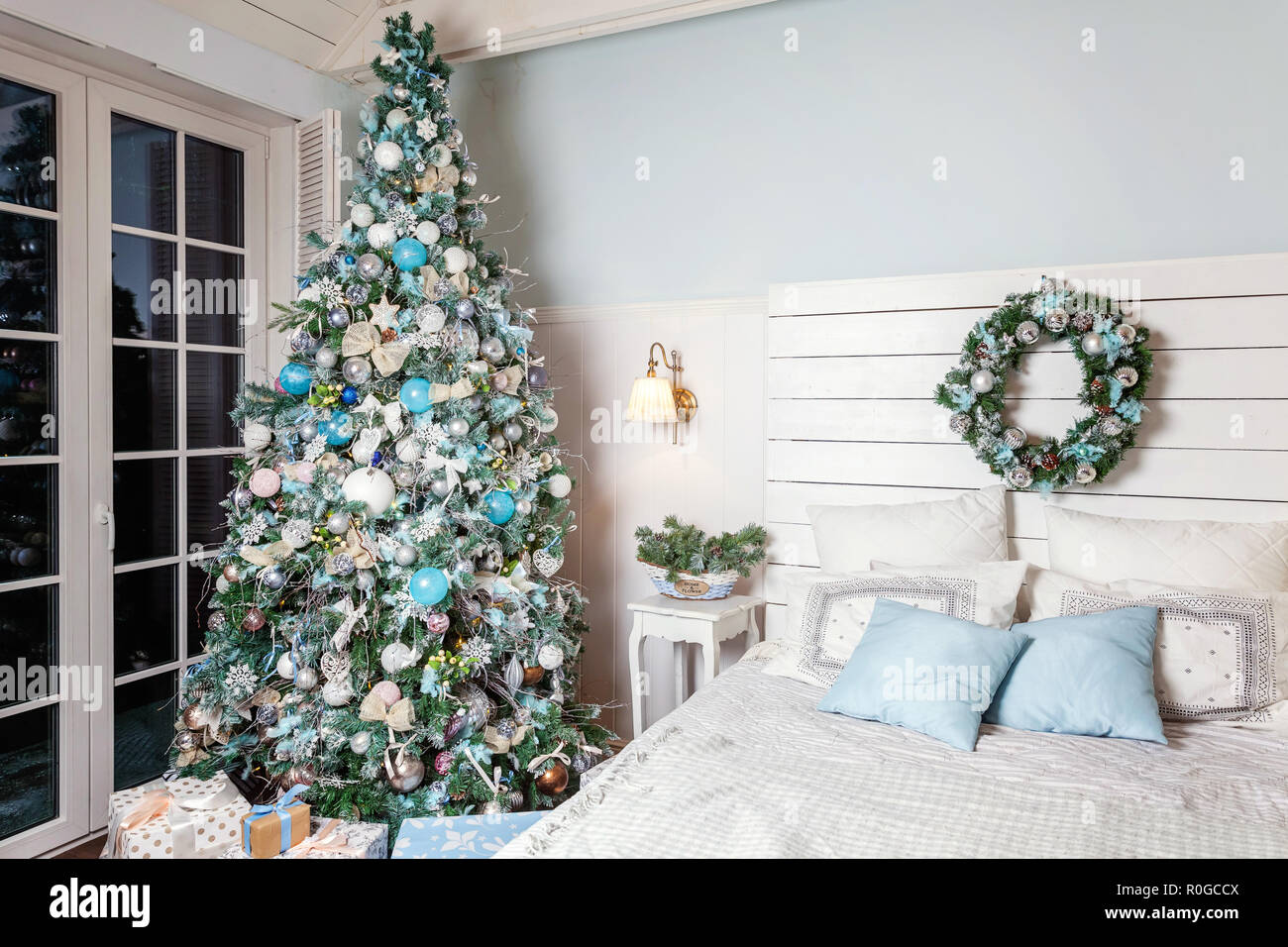 classic christmas decorated interior room new year tree christmas tree with silver decorations modern white classical style interior design apartment bedroom with bed christmas eve at home stock photo alamy https www alamy com classic christmas decorated interior room new year tree christmas tree with silver decorations modern white classical style interior design apartment bedroom with bed christmas eve at home image224095786 html