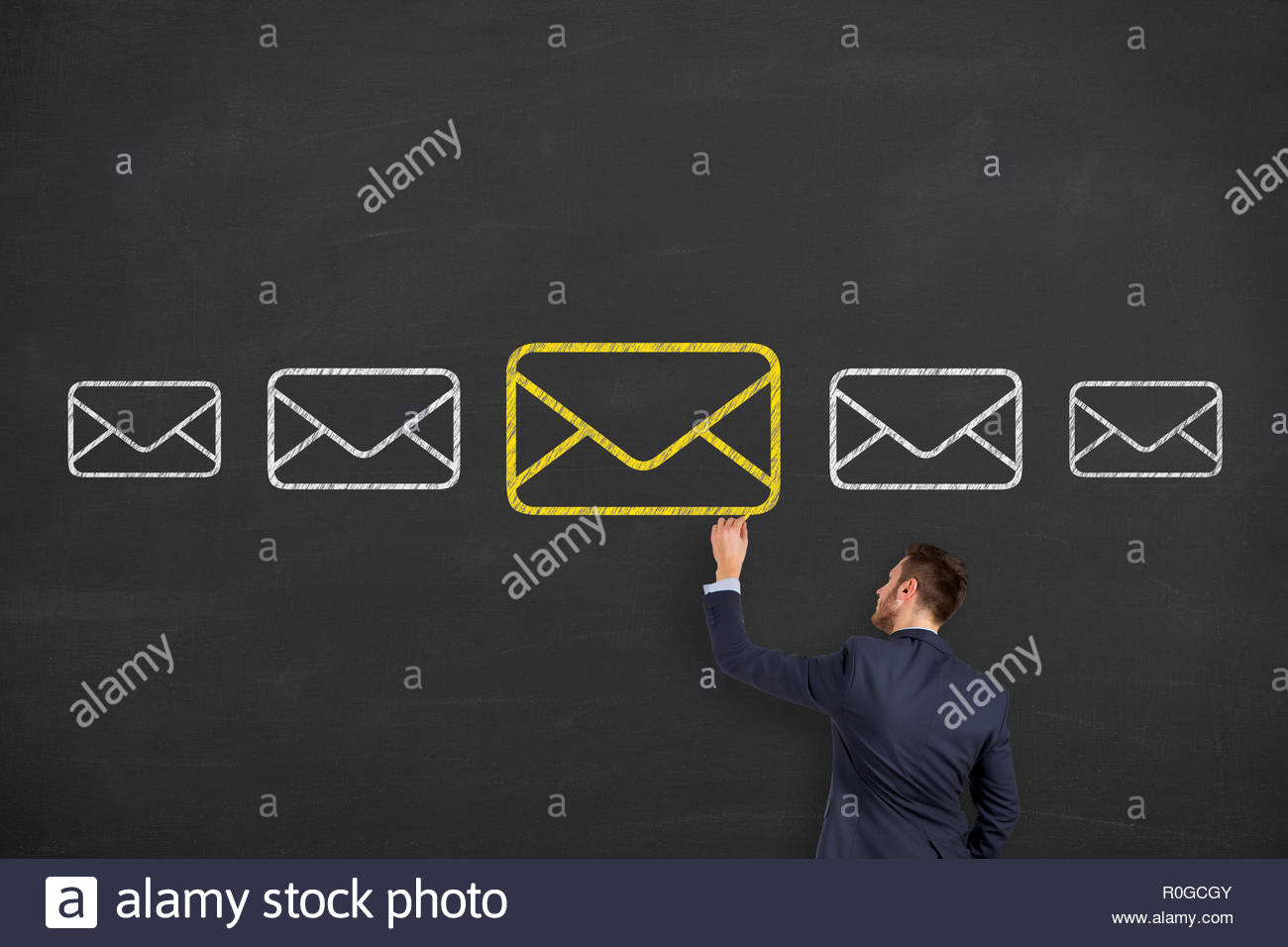 Email marketing newsletter and bulk mail concepts on blackboard - Stock Image