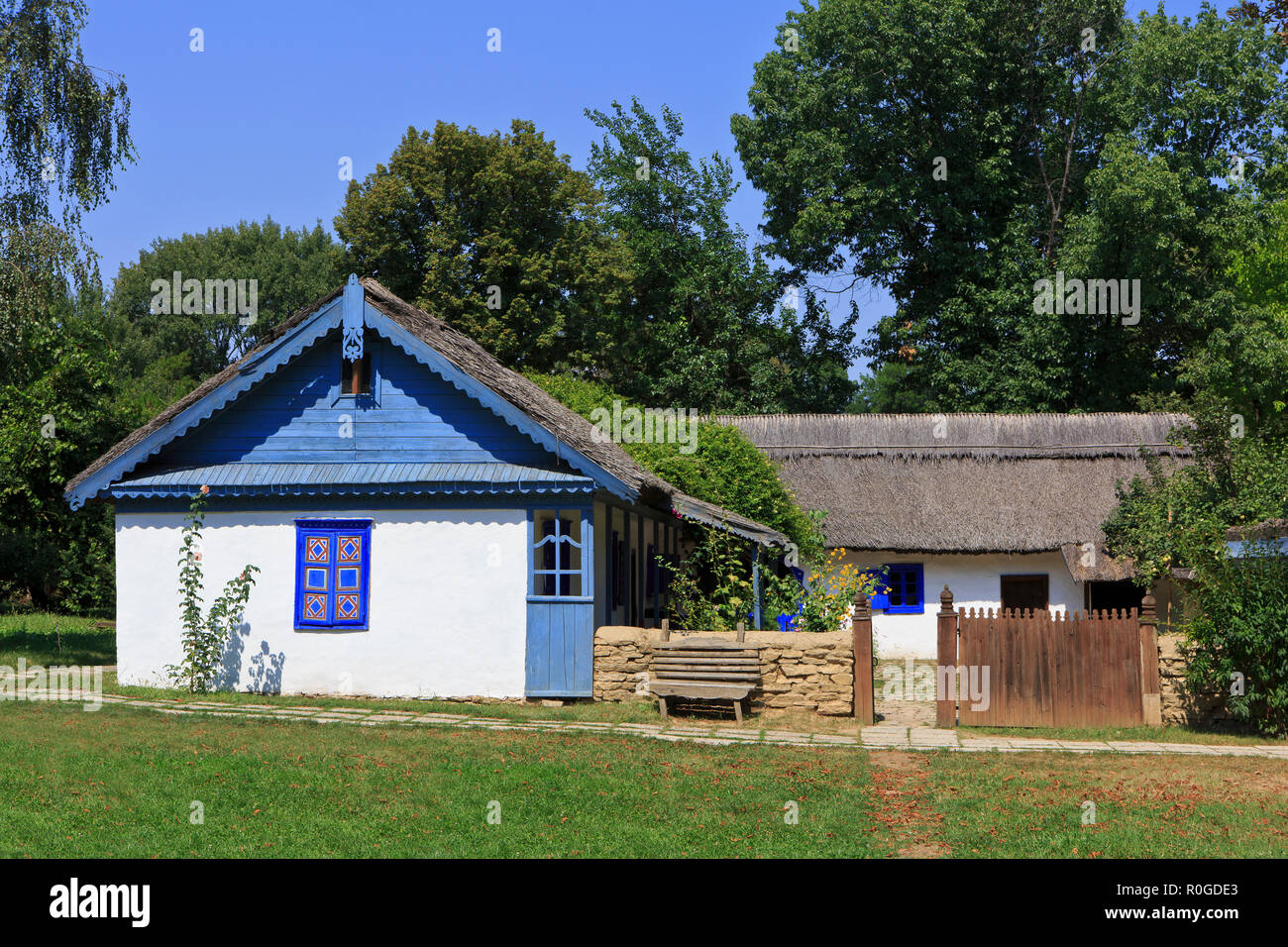 A beautiful traditional farmhouse at the Dimitrie Gusti National Village Museum in Bucharest, Romania - Stock Image