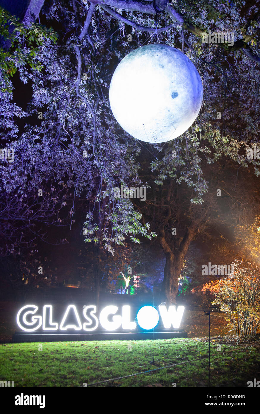 Sign at the entrance to GlasGLOW, a winter event in Glasgow when the Botanic Gardens are lit up at night. - Stock Image