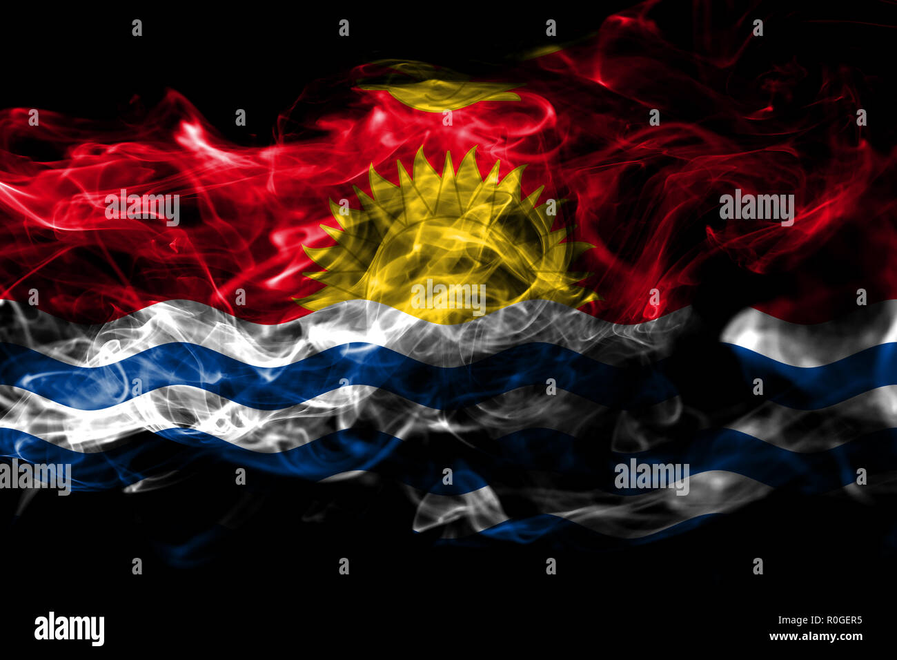 National flag of Kiribati made from colored smoke isolated on black background. Abstract silky wave background - Stock Image