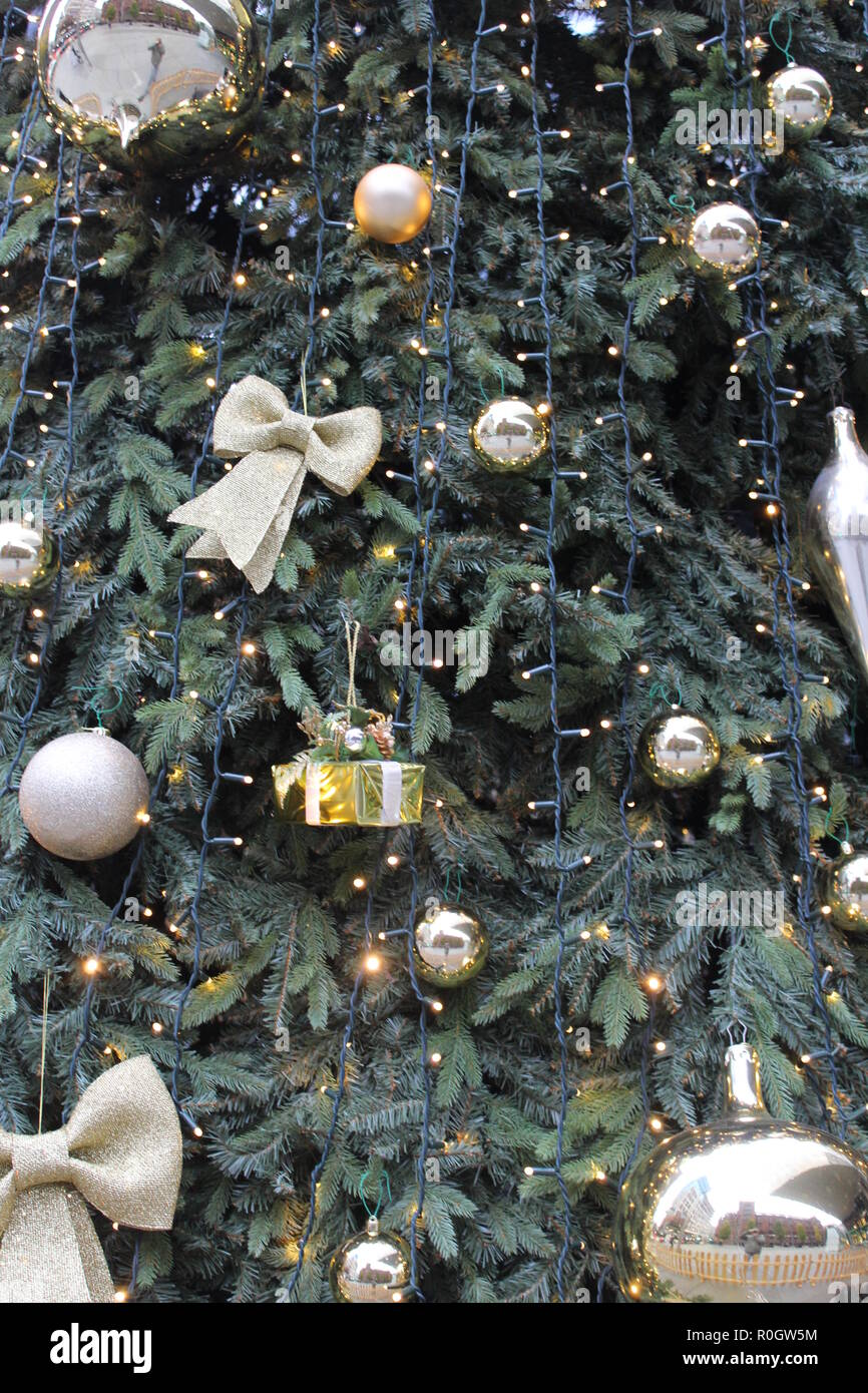 Christmas tree with golden decorations outdoors in Manchester - Christmas ornaments - Stock Image