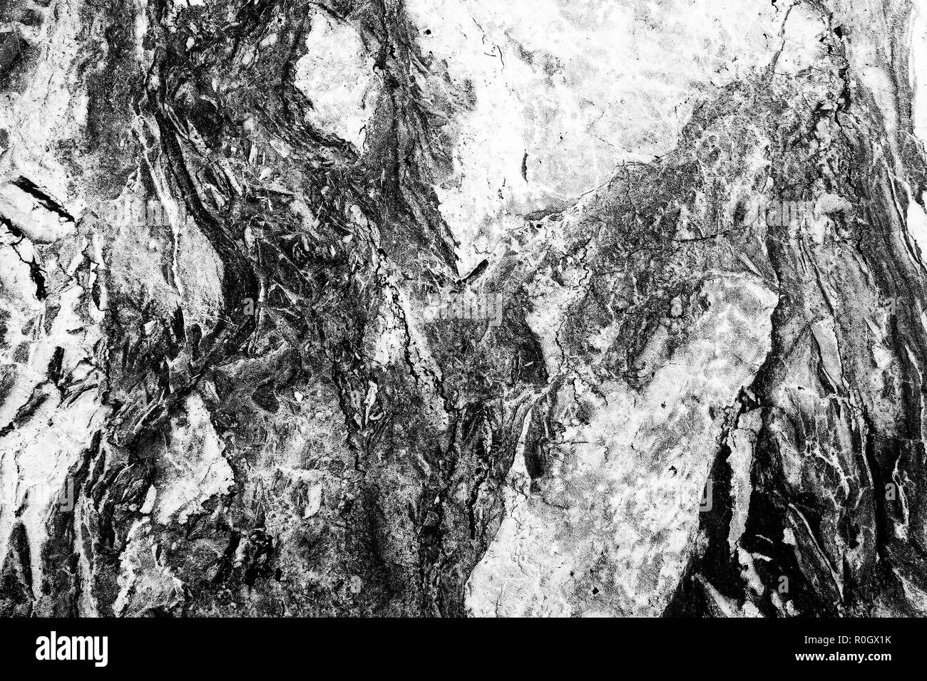 Black and white high contrast marble texture, desaturated high contrast image - Stock Image