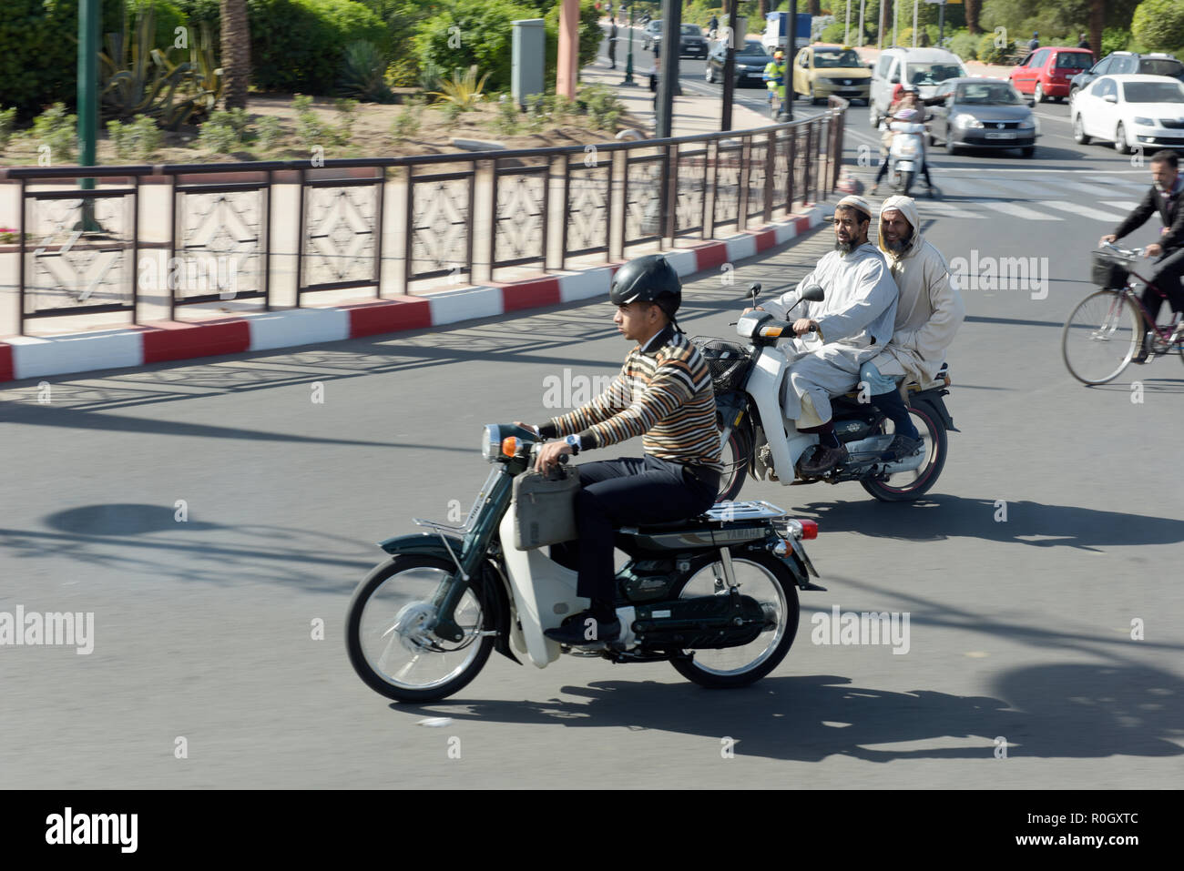 Mopeds in Traffic in Marrakech Morocco - Stock Image