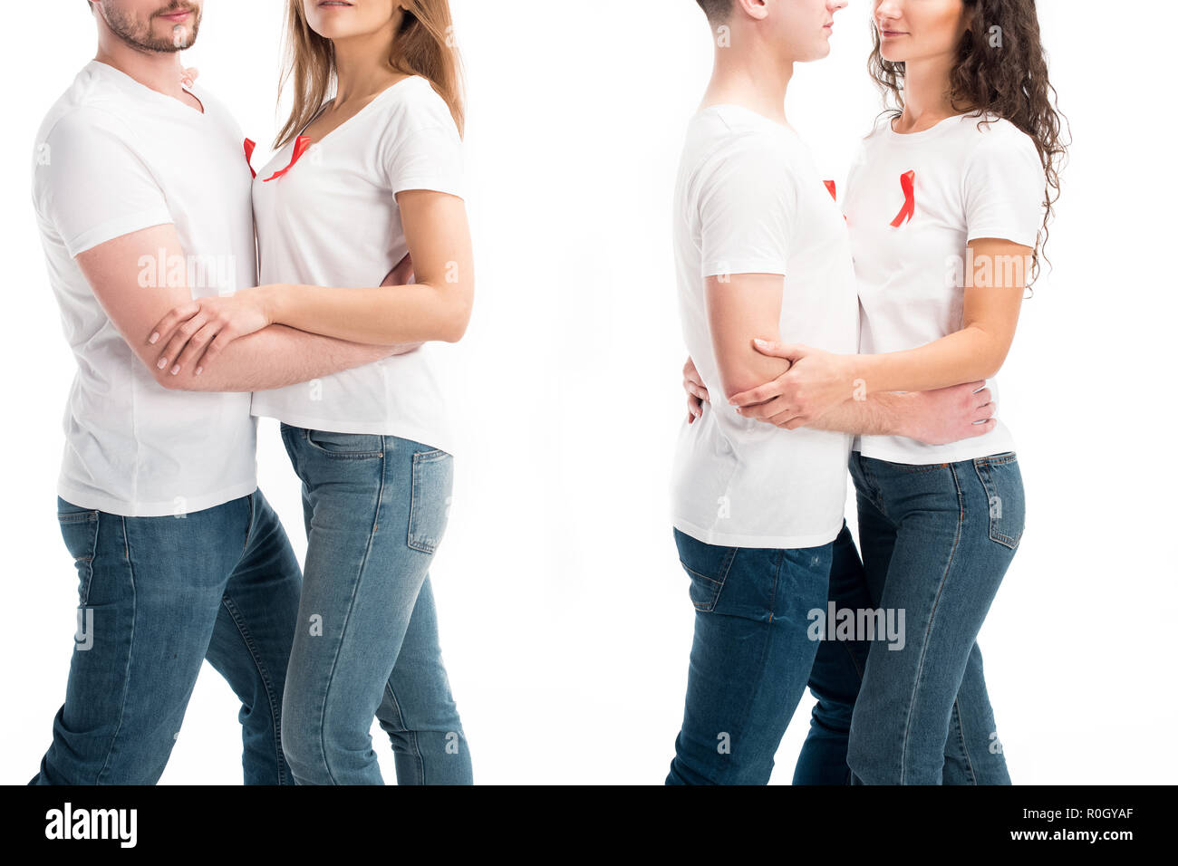 cropped image of two heterosexual couples with red ribbons hugging isolated on white, world aids day concept - Stock Image