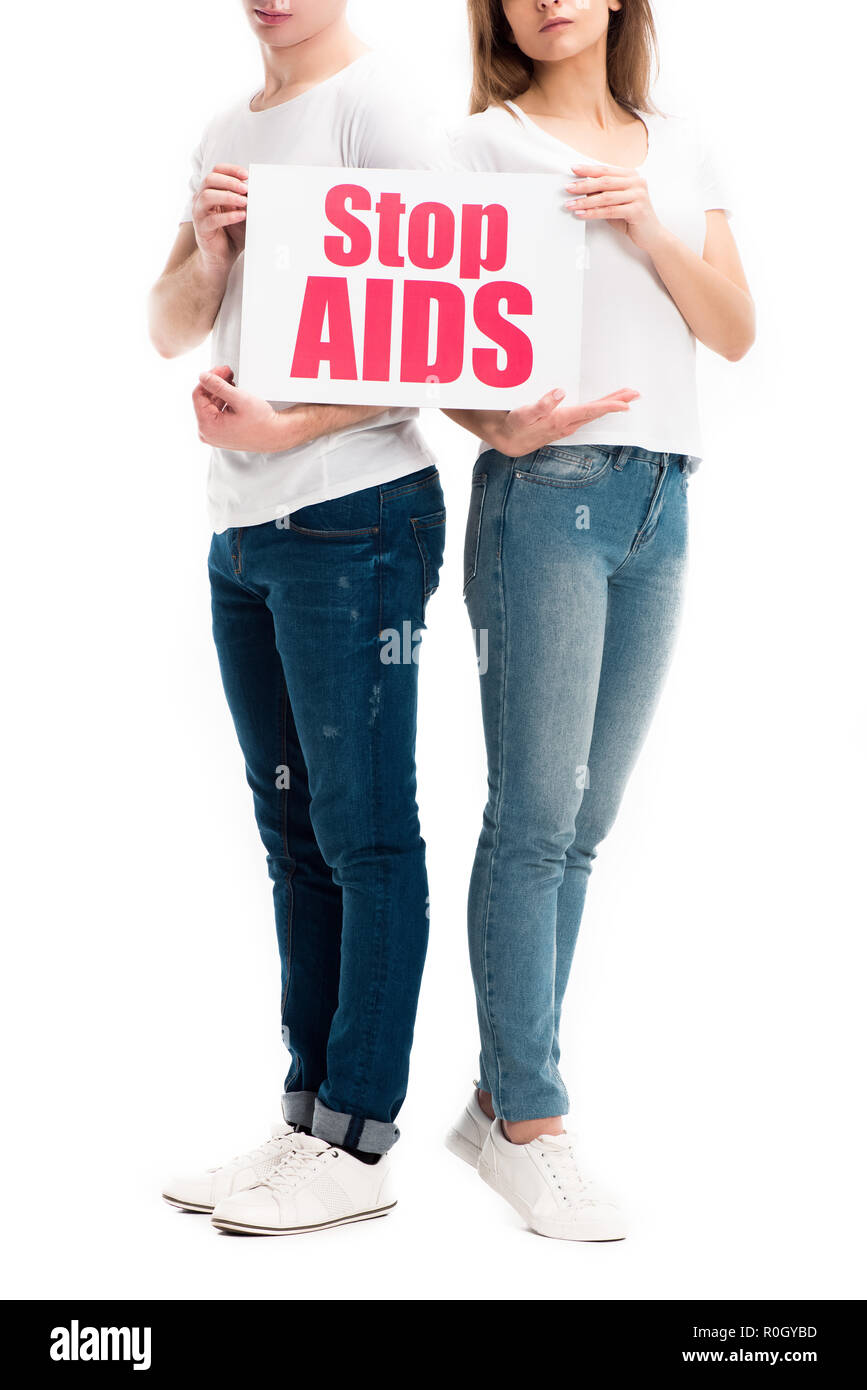 cropped image of heterosexual couple holding card with stop aids text isolated on white - Stock Image