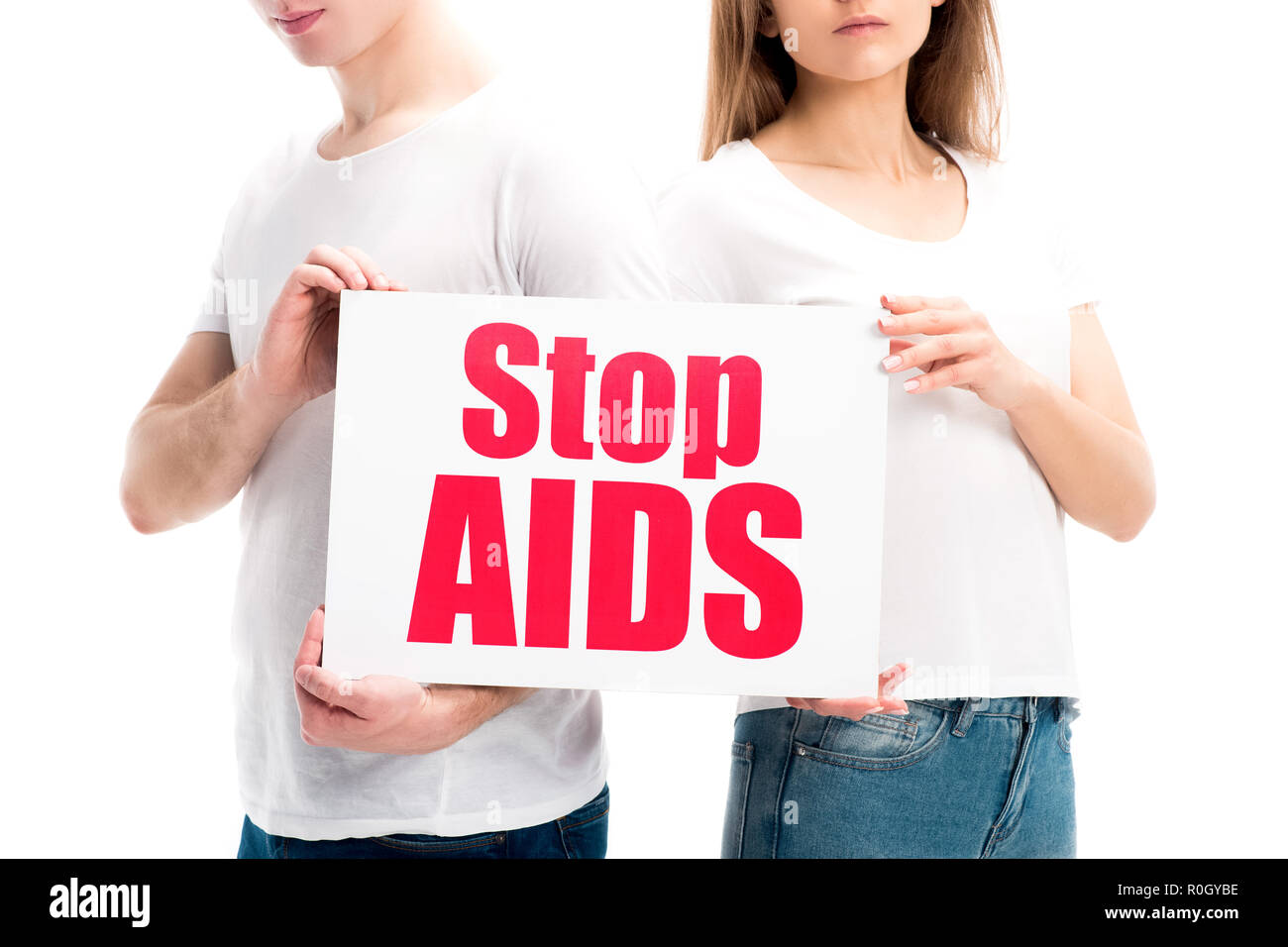 cropped image of heterosexual couple holding card with stop aids text isolated on white, world aids day concept - Stock Image