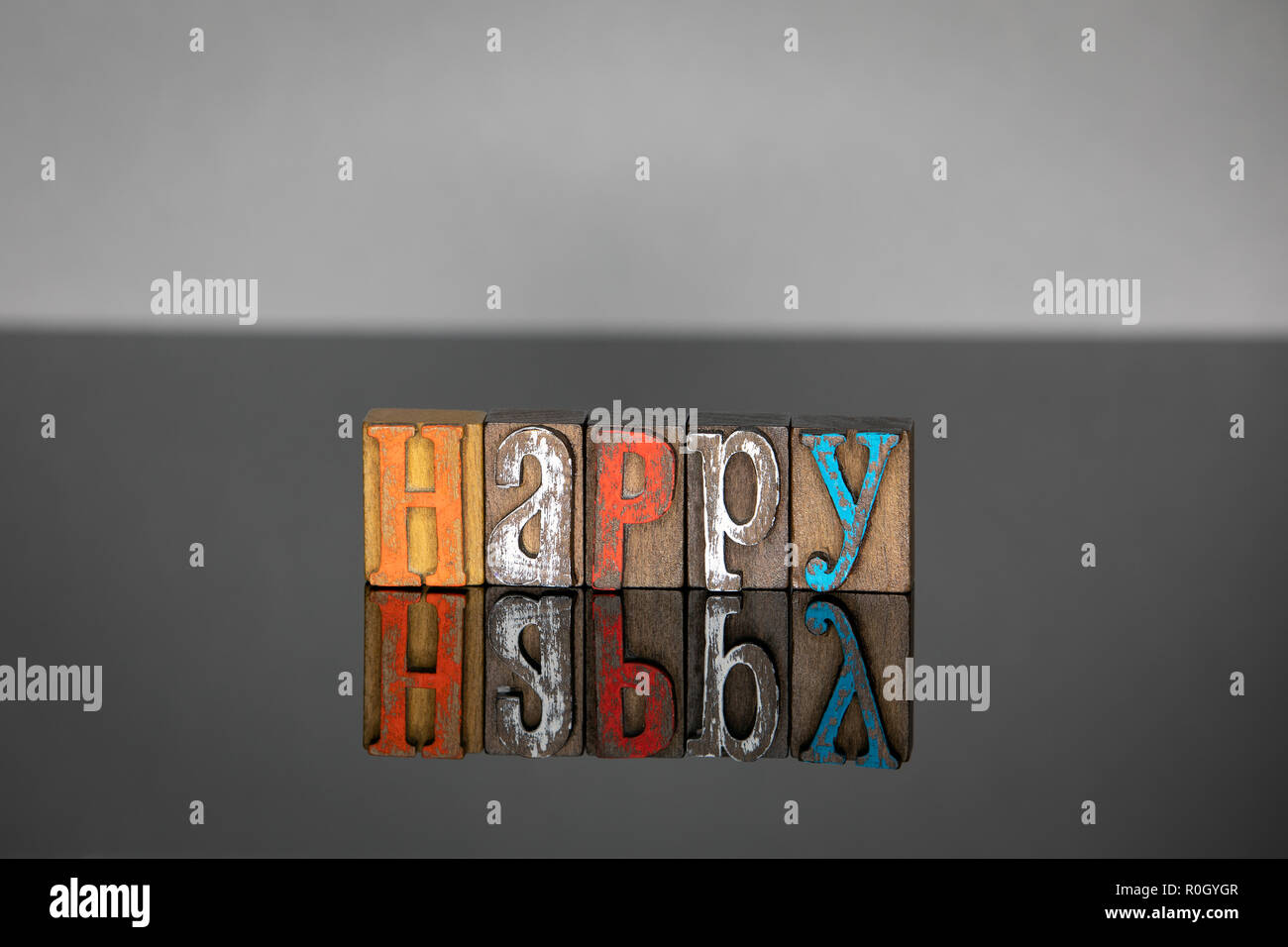 Happy word from colored wooden letters  - Stock Image