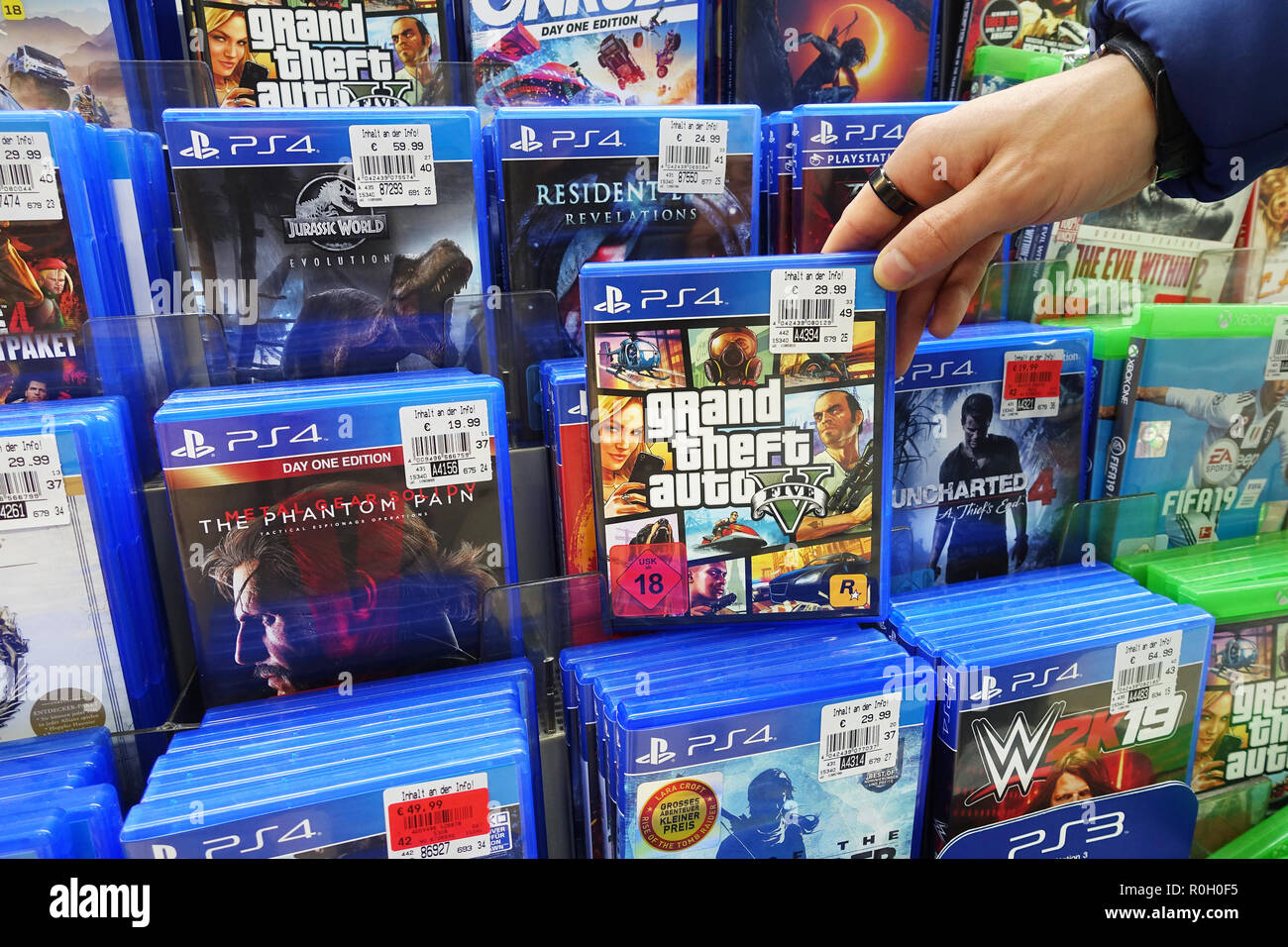 Store display filled with PlayStation 4 games for a home