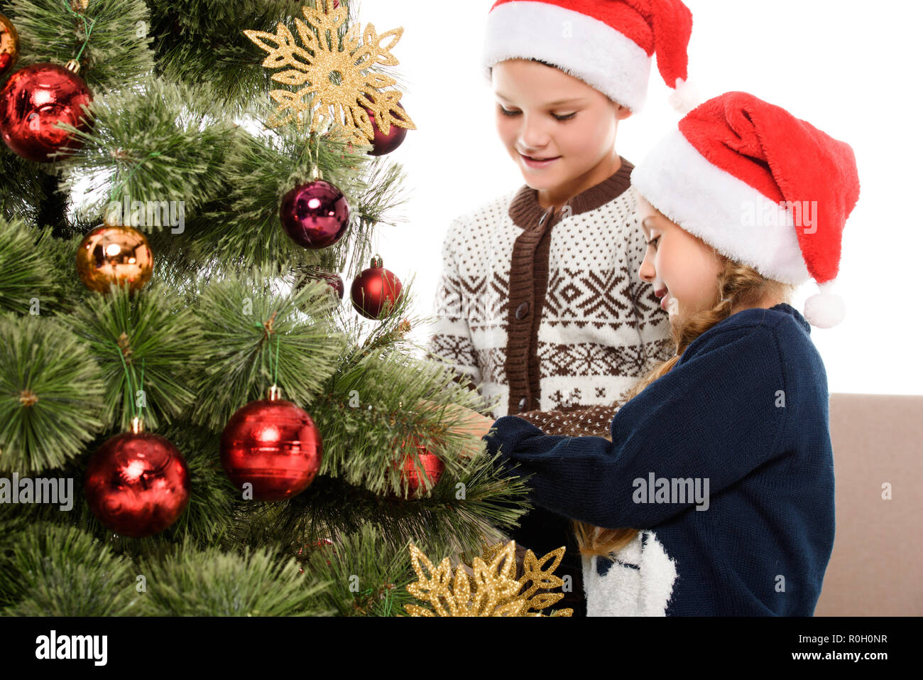 Happy Kids In Santa Hat Decorating Christmas Tree Together Isolated On White Stock Photo Alamy