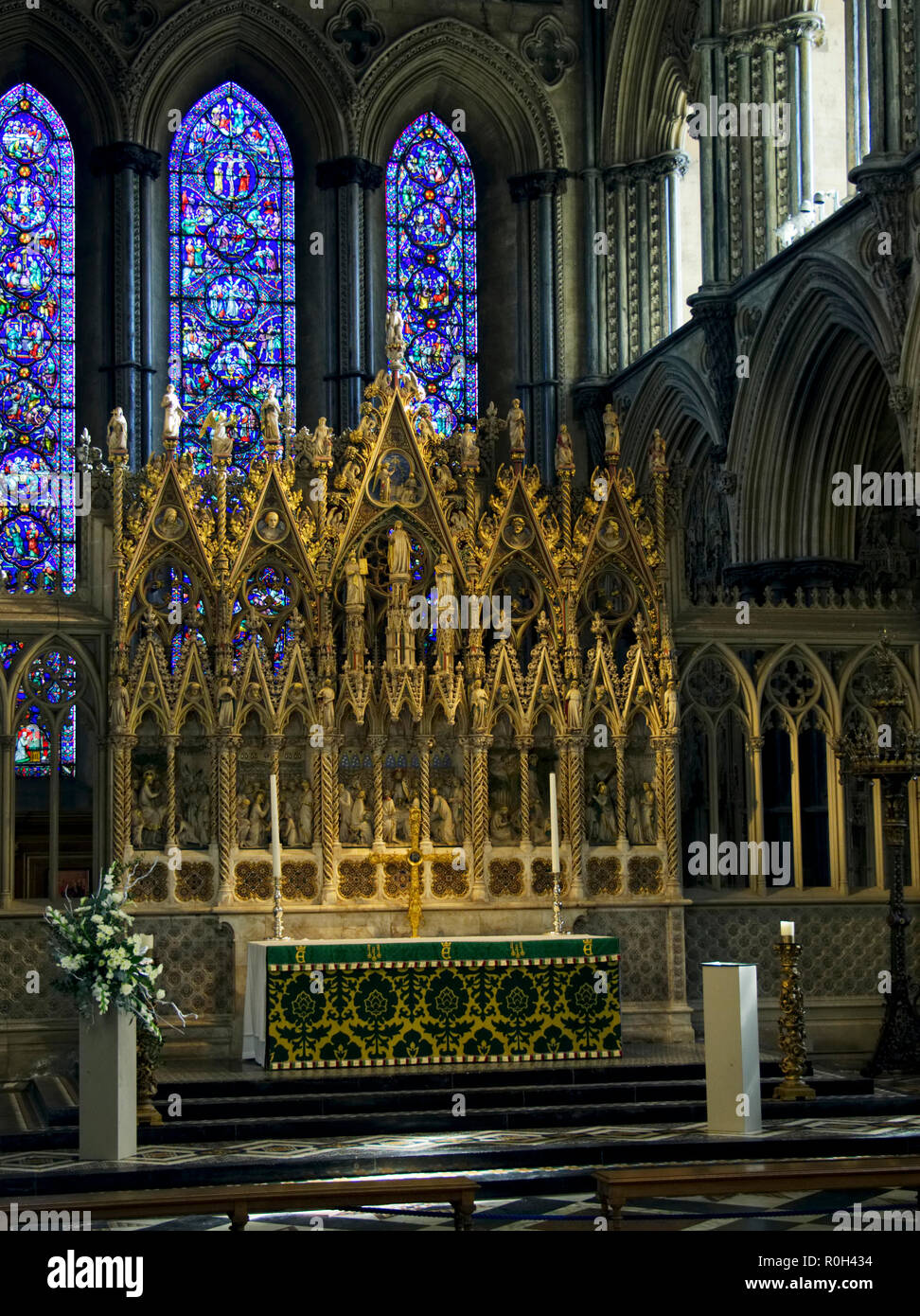 The magnificent ornately carved and gold painted High Altar of Ely Cathedral in Cambridgeshire. Stock Photo