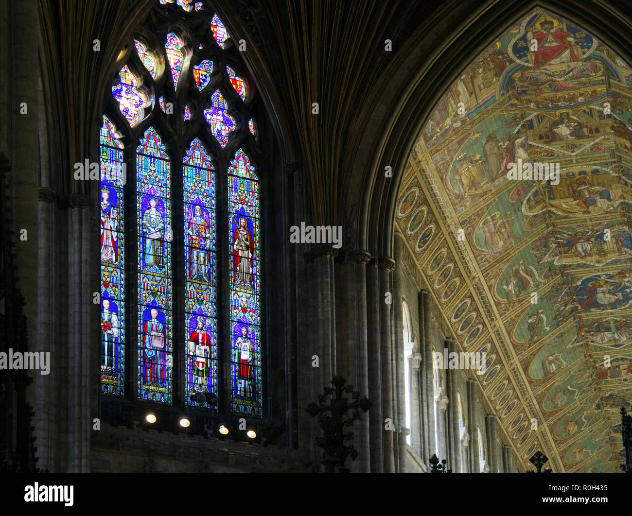 Stained glass window and magnificent painted ceiling in Ely Cathedral, Cambridgeshire. Stock Photo