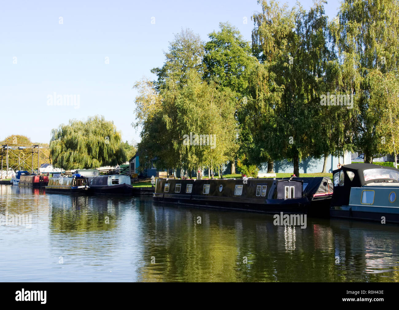 The Great Ouse river flowing through the pretty cathedral town of Ely, Cambridgeshire is popular with boating enthusiasts and barge dwellers. Stock Photo