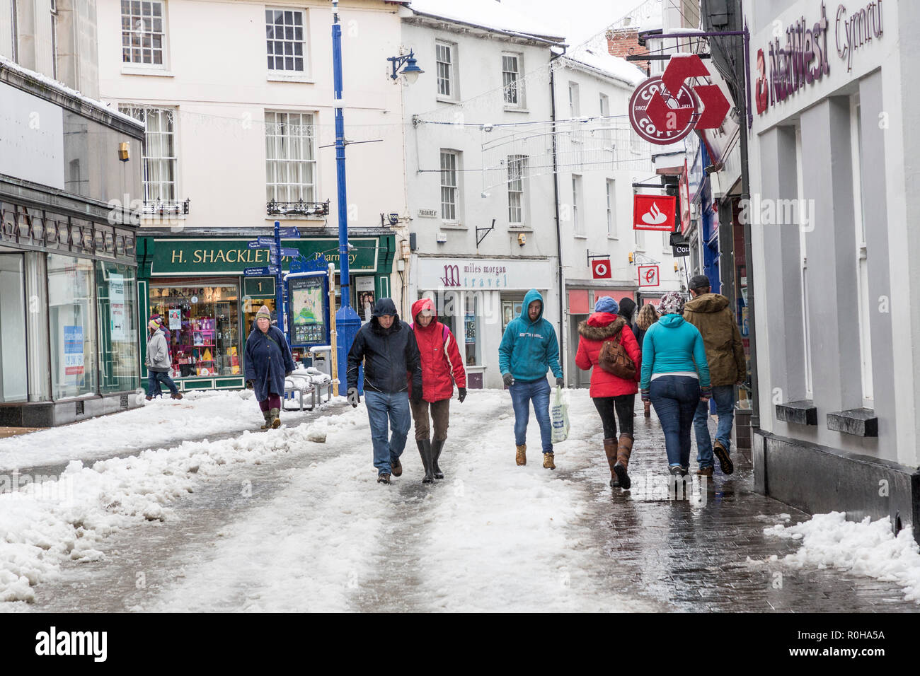 People in icy shopping street, Abergavenny, Wales, UK - Stock Image