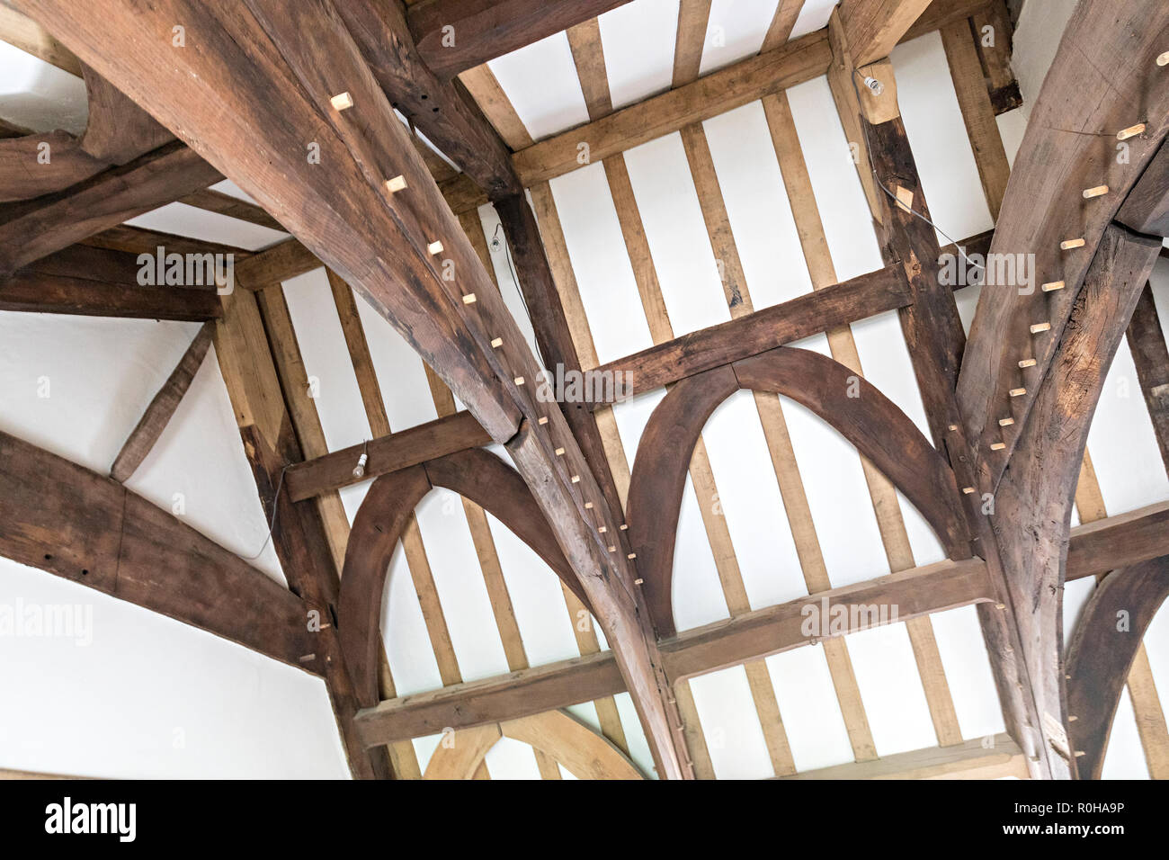 Roof interior with pegged beams at house restoration by the Landmark Trust, Llwyn y Celyn, Lower Cwmyoy, Wales, UK - Stock Image