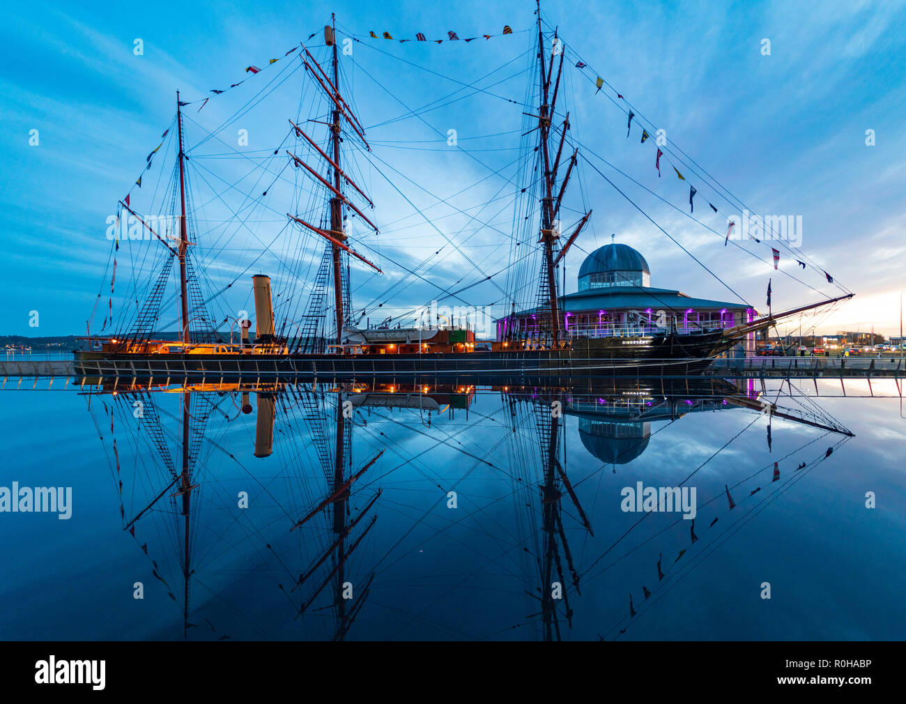 Reflection  of RRS Discovery ship at Discovery Point museum in the evening in Dundee, Tayside, Scotland, UK - Stock Image