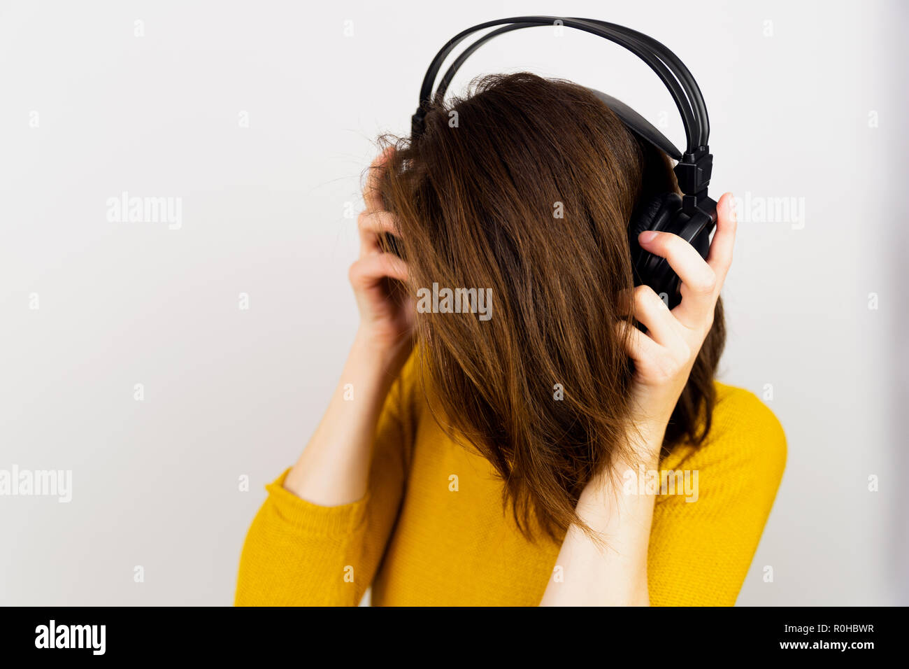 Beautiful women listening to music with headphones. - Stock Image