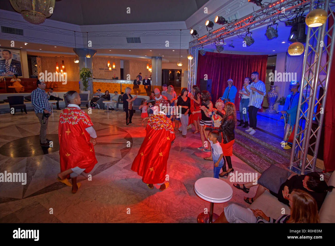 Guests join Moroccan folk performers at a Moroccan Night held at the Kenzi Europa Hotel in Agadir, Souss-Massa, Morocco. - Stock Image
