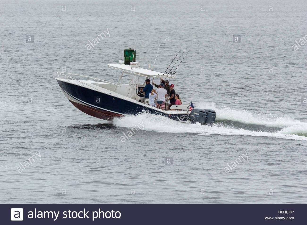 New Bedford, Massachusetts, USA - September 3, 2018: Recreational fishing boat cruising toward Buzzards Bay from New Bedford - Stock Image