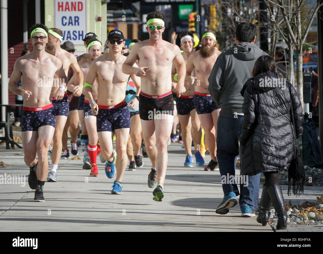 Vancouver, Canada. 4th Nov, 2018. Participants run on the street during the Movember Undie Run in Vancouver, Canada, Nov. 4, 2018. Hundreds of runners participated in the event to raise public awareness of men's health issues. Credit: Liang Sen/Xinhua/Alamy Live News - Stock Image