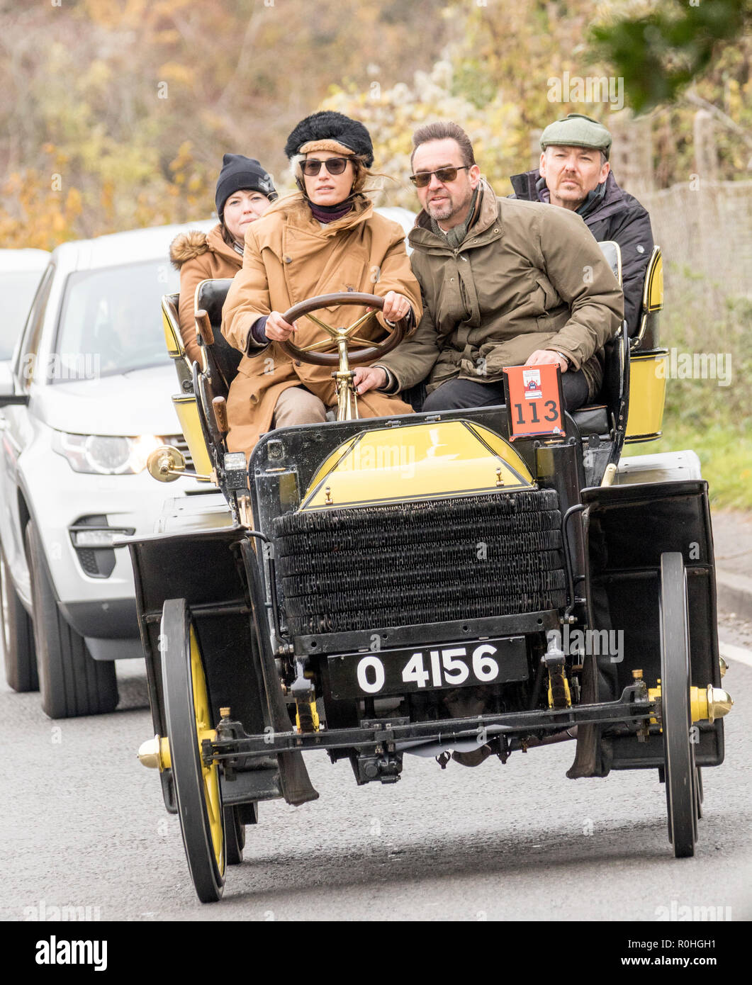 "Pyecombe, East Sussex, UK. 4th November 2018. Yasmin Le Bon seen here driving takes part in the 79th  ""Bonham's"" London to Brighton Veteran car run. The 60 mile route, starting in Hyde Park London concludes at Madeira Drive Brighton. The vehicles in this year annual event, including an 1895 Peugeot and an 1898 Panhard et Levassor were all built between 1893 and 1905. Credit: Newspics UK South/Alamy Live News - Stock Image"
