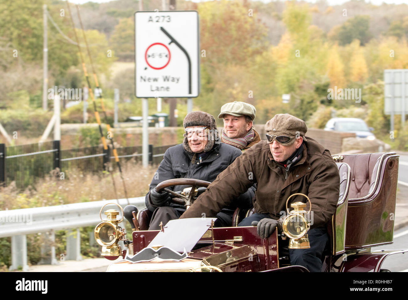 """Pyecombe, East Sussex, UK. 4th November 2018. Christian Horner of Red Bull racing with Lord Laidlaw in the Lords 1904 Panhard-Levassor as they join owners and drivers take for the 79th  """"Bonham's"""" London to Brighton Veteran car run. The 60 mile route, starting in Hyde Park London concludes at Madeira Drive Brighton. The vehicles in this year annual event, including an 1895 Peugeot and an 1898 Panhard et Levassor were all built between 1893 and 1905. Stock Photo"""