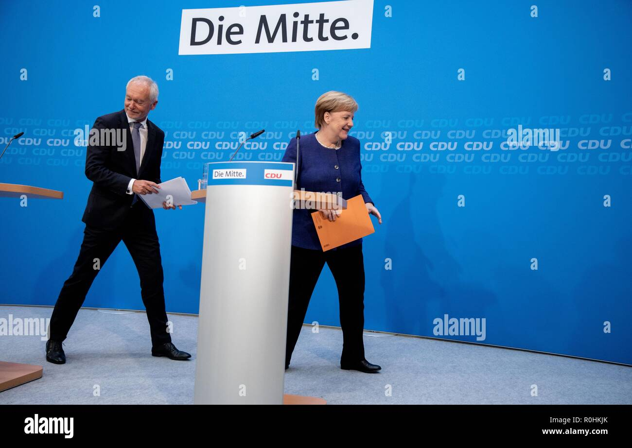 Berlin, Germany. 05th Nov, 2018. Chancellor Angela Merkel (CDU) is leaving the press conference at the CDU headquarters in the Konrad-Adenauer-Haus with Klaus Schüler, CDU federal managing director. The topic was the results of the CDU retreat. Credit: Kay Nietfeld/dpa/Alamy Live News - Stock Image