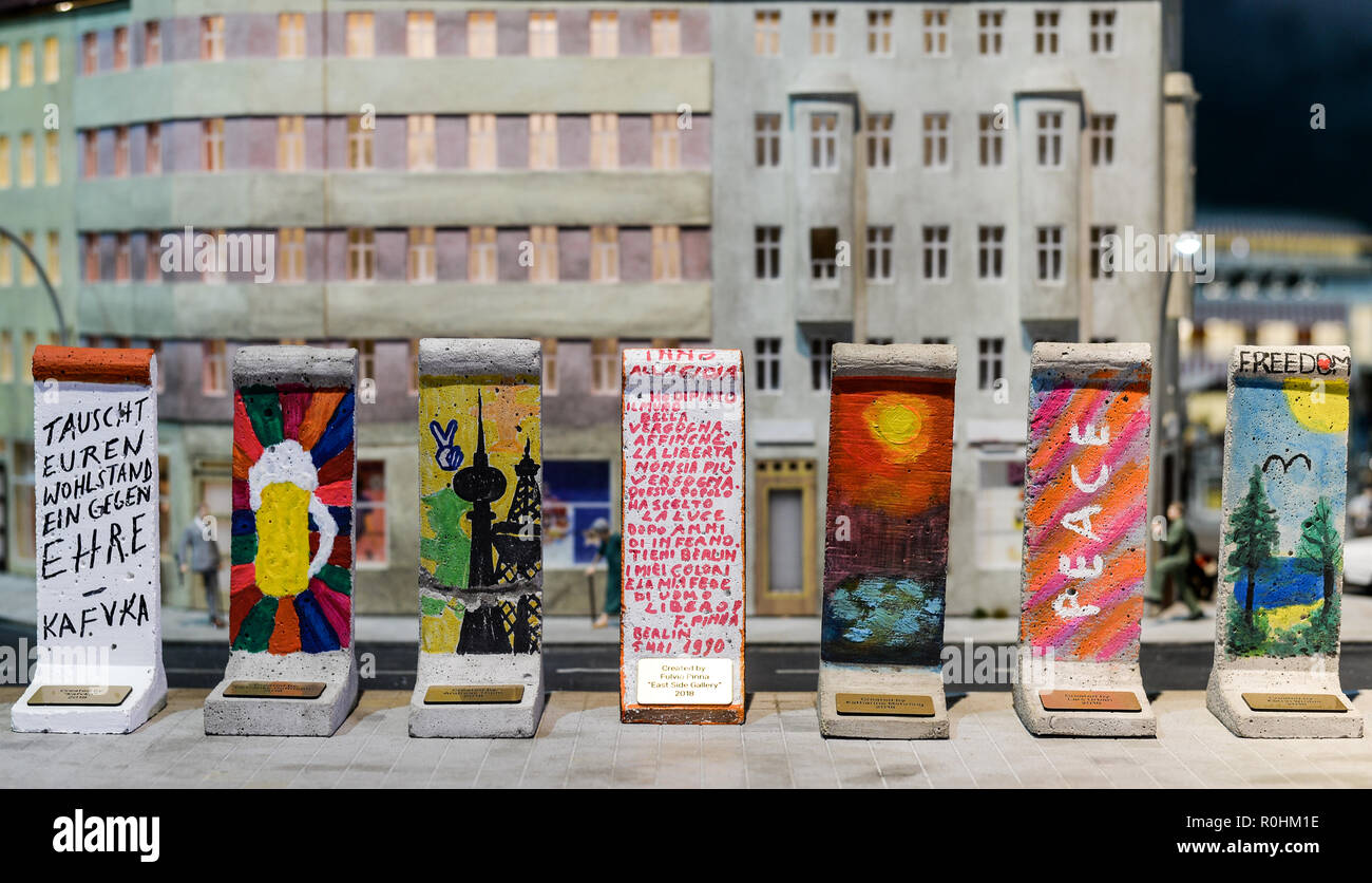 """Berlin, Germany. 05th Nov, 2018. Wall elements designed by celebrities on a scale of 1:21 will be shown in the exhibition at a press event on the anniversary of the fall of the Berlin Wall 28 years ago in Little Big City Berlin. The mini wall pieces can be bought at auction and the proceeds go to the organisation """"Merlin's Magic Wand"""", which supports needy children. Credit: Jens Kalaene/dpa-Zentralbild/ZB/dpa/Alamy Live News Stock Photo"""