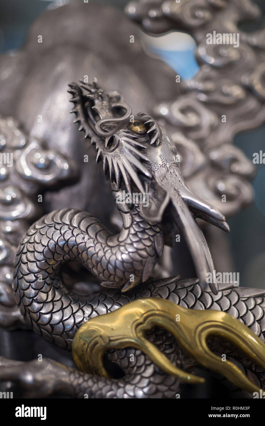 Bonhams, New Bond Street, London, UK. 5 November, 2018. The preview of Bonhams Fine Japanese, Fine Chinese and The Ollivier Collection of Early Chinese Art: A Journey Through Time sale is held  before Asian Art Week. Image: Detail from a large and unusual silver, shibuich and gilt Okimono of a Dragon Ascending mount Fuji, Meiji era, estimate £30,000-50,000. Credit: Malcolm Park/Alamy Live News. Stock Photo