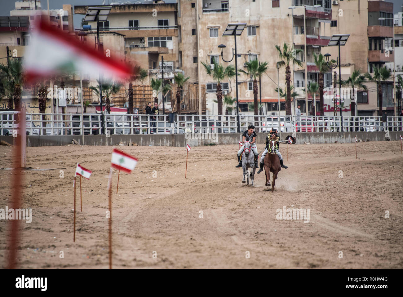 November 4, 2018 - Saida, Lebanon - Jockeys are seen competing during the horse race..Horse race at the Saida festival for speed, held on a public town beach, organised by a joint effort from the municipality of Sidon and the Ride-Along Club. (Credit Image: © Elizabeth Fitt/SOPA Images via ZUMA Wire) - Stock Image