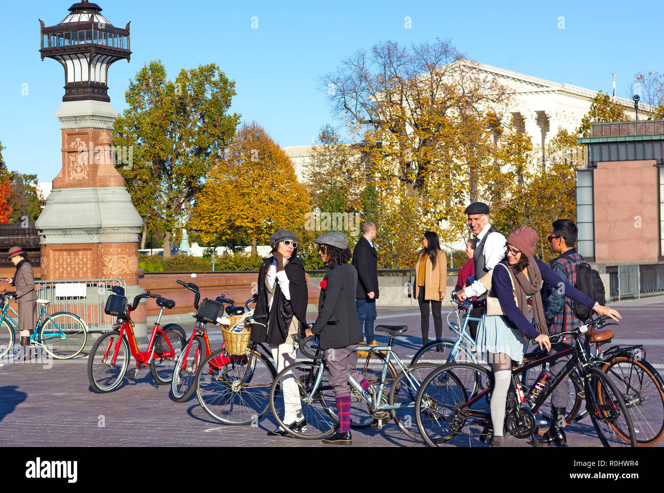Washington DC, USA. 4th Nov 2018. Participants of DC's 2nd Tweed Ride enjoy a beautiful Sunday after the event on the US Capitol grounds. The Ride of cyclists who refuse to endure anymore spandex and feel great to spin through our beautiful streets in the finest most dapper attire. Credit: Andrei Medvedev/Alamy Live News - Stock Image