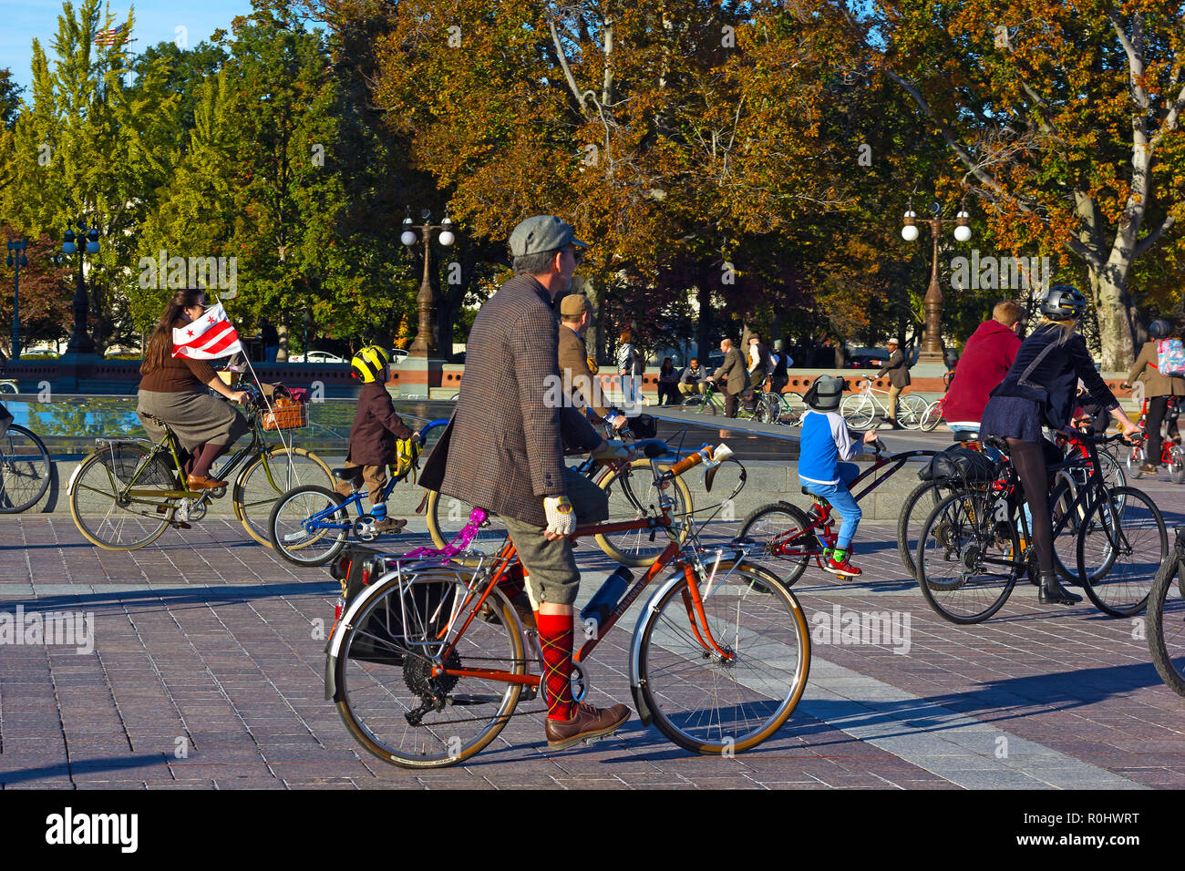 Washington DC, USA. 4th Nov 2018. Participants of DC's 2nd Tweed Ride event meticulously dressed for their bike ride on the US Capitol grounds. Ride of cyclists who refuse to endure anymore spandex and feel great to spin through our beautiful streets in the finest most dapper attire. Credit: Andrei Medvedev/Alamy Live News - Stock Image