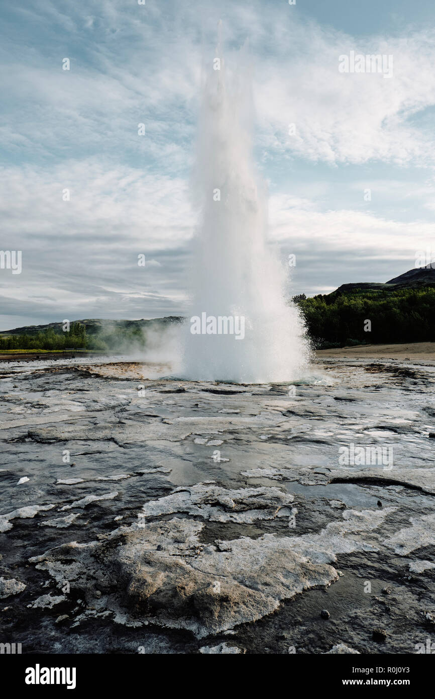 Strokkur in the popular tourist destination of Geysir hot spring in the geothermal area of Haukadalur Valley, found in south-west Iceland. - Stock Image