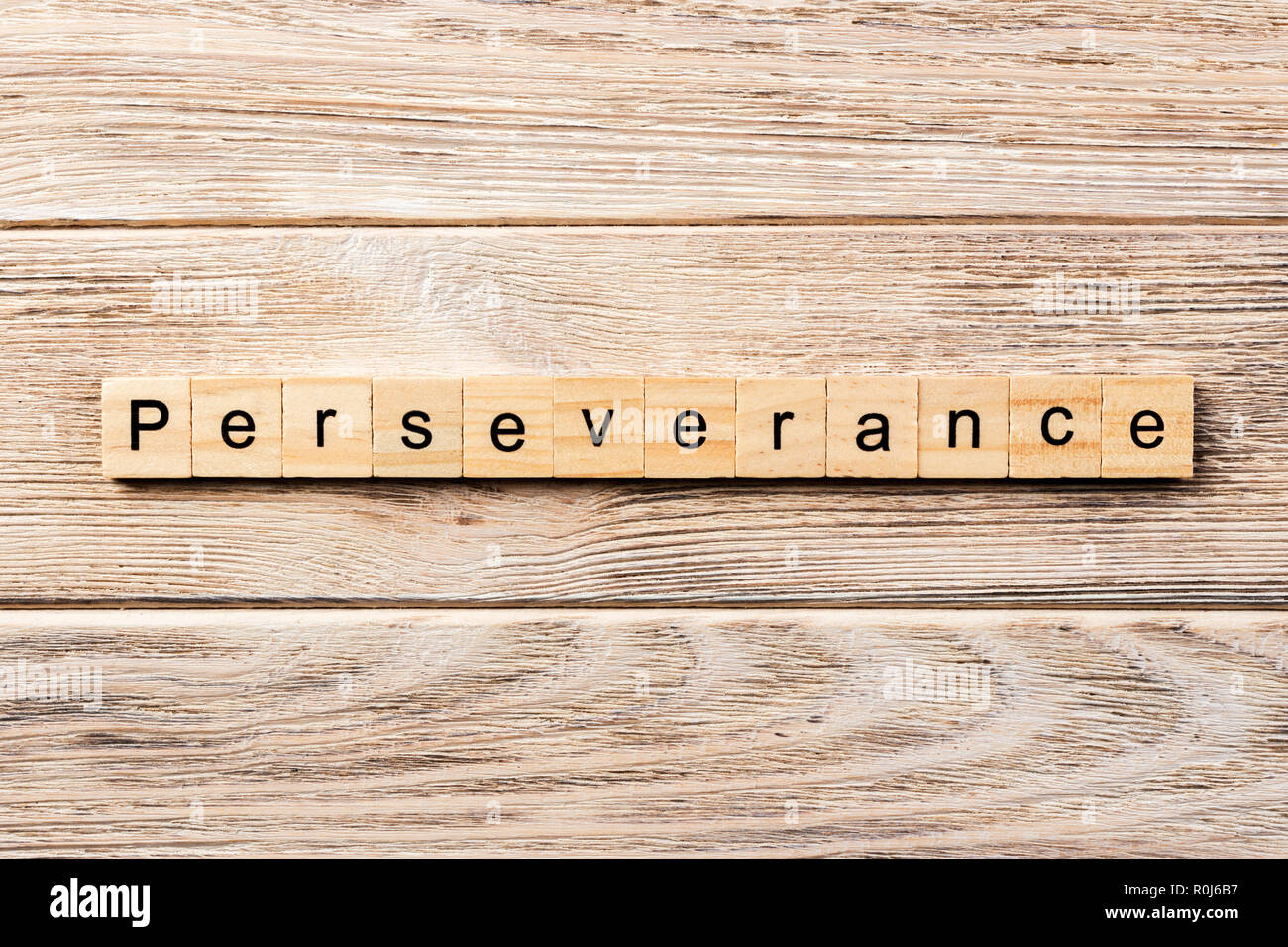 perseverance word written on wood block. perseverance text on table, concept. Stock Photo