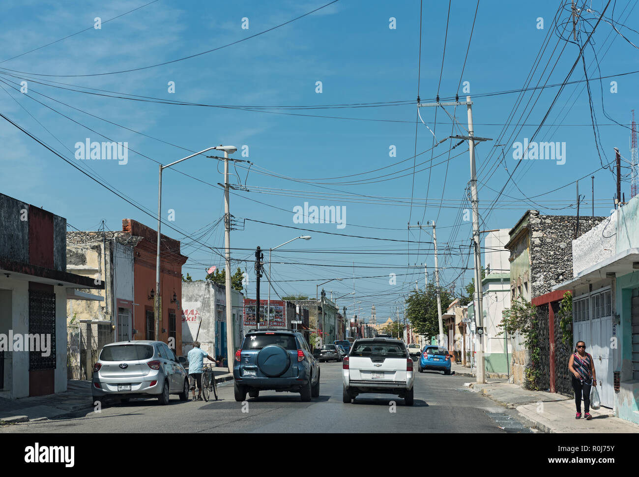 street with houses and shops in downtown merida, mexico. - Stock Image