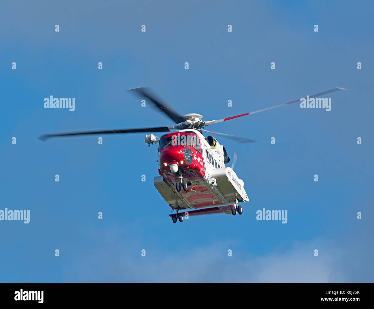 Inverness based Sikorsky S-92 HM Coastguard helicopter G MCGI departing to the Orkney Isles on a cll out mission. - Stock Image