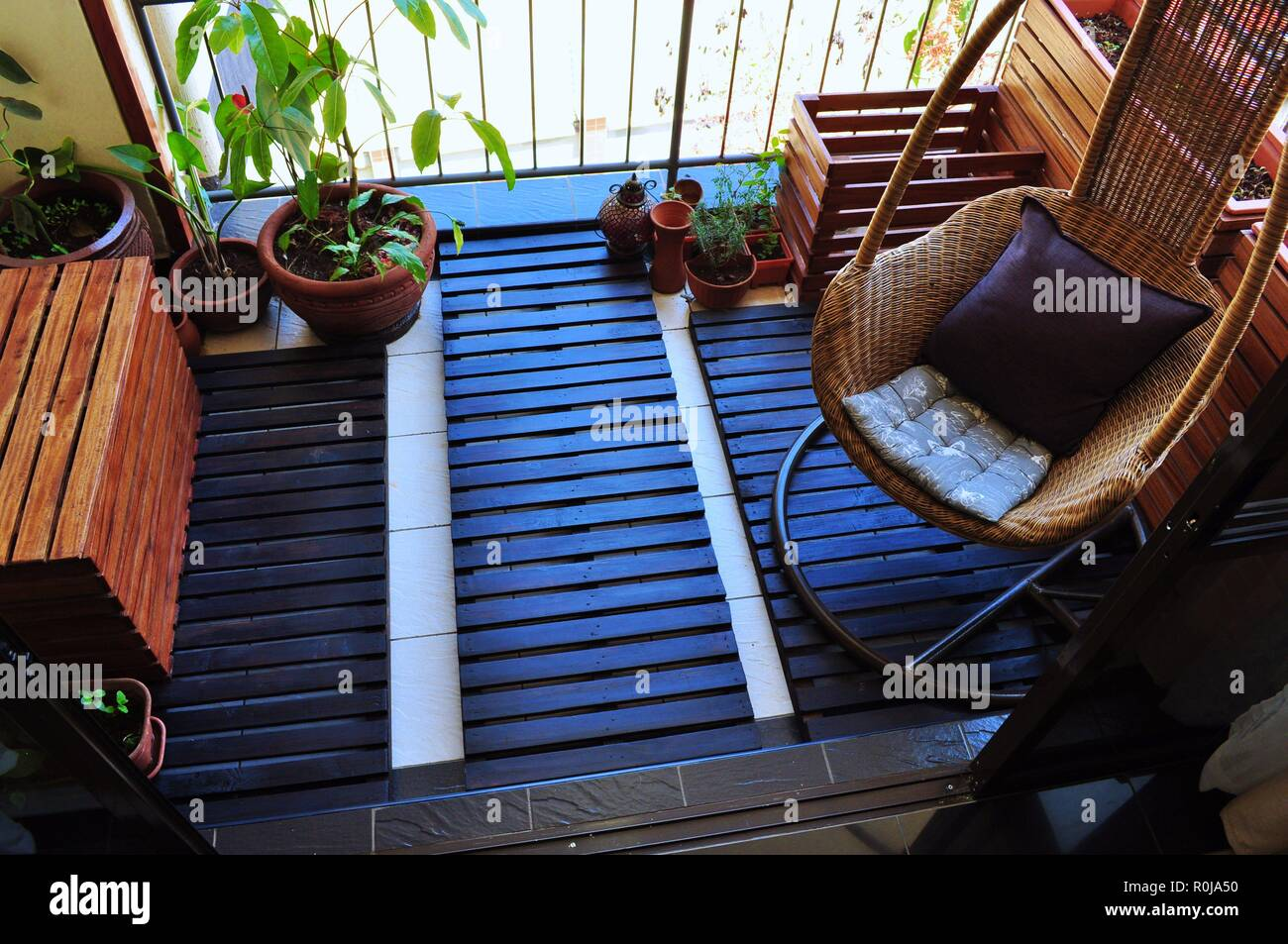 View of our beautiful small Balcony Garden on a sunny day, this is our best way to go green , relaxing and refreshing, mainly used wood - Stock Image