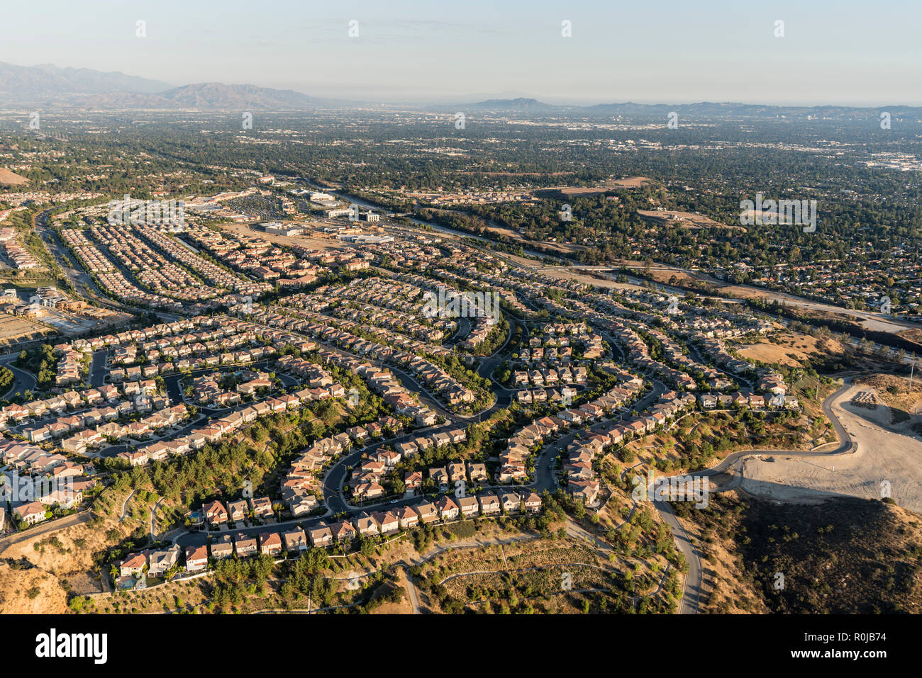 Aerial view of Porter Ranch cul de sac streets and the San Fernando Valley in Los Angeles, California. - Stock Image