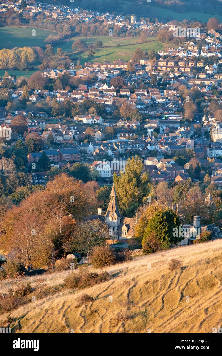Clock tower in stanley park in Selsley village. View from selsley common across the stroud valley in autumn at sunset. Cotswolds, Gloucestershire, UK Stock Photo