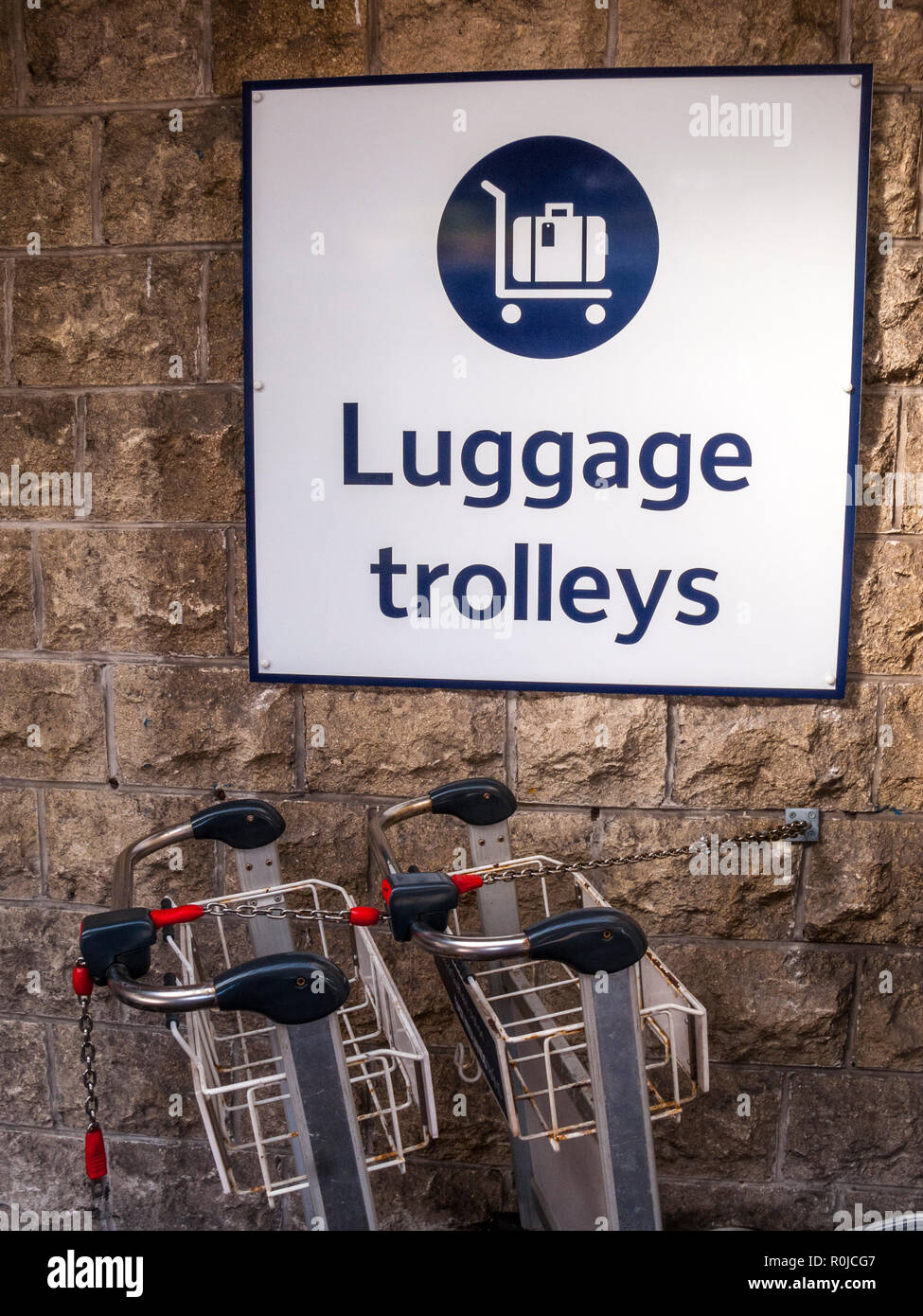 Luggage Trolleys and Wall Sign, Sheffield Station - Stock Image